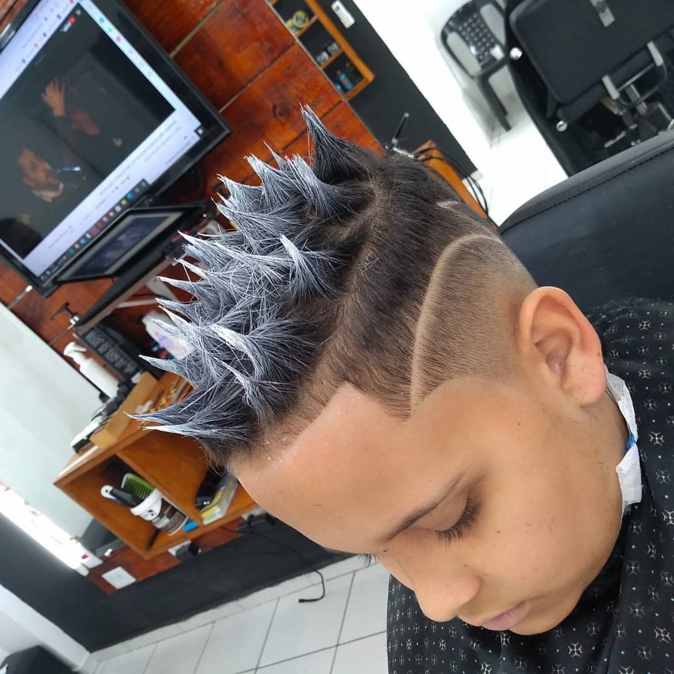 A messy spiky fade haircut for boys.