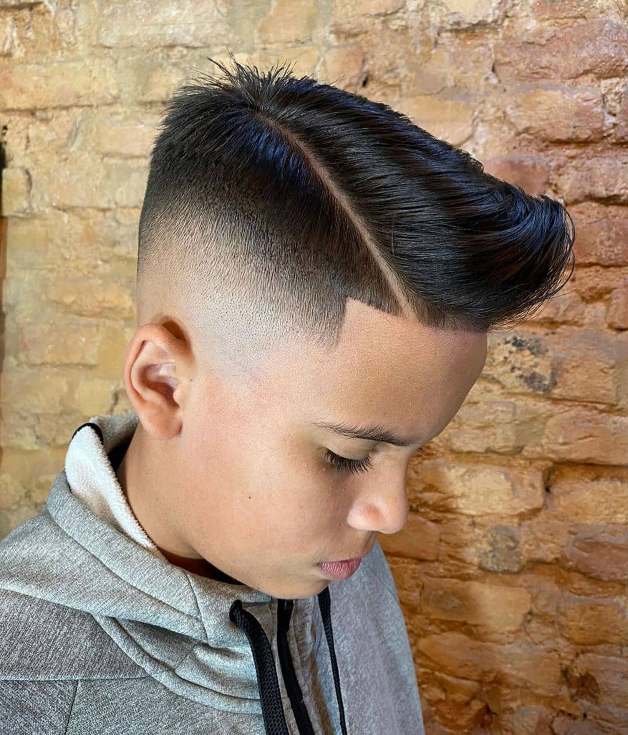 A trendy high-faded haircut for boys.