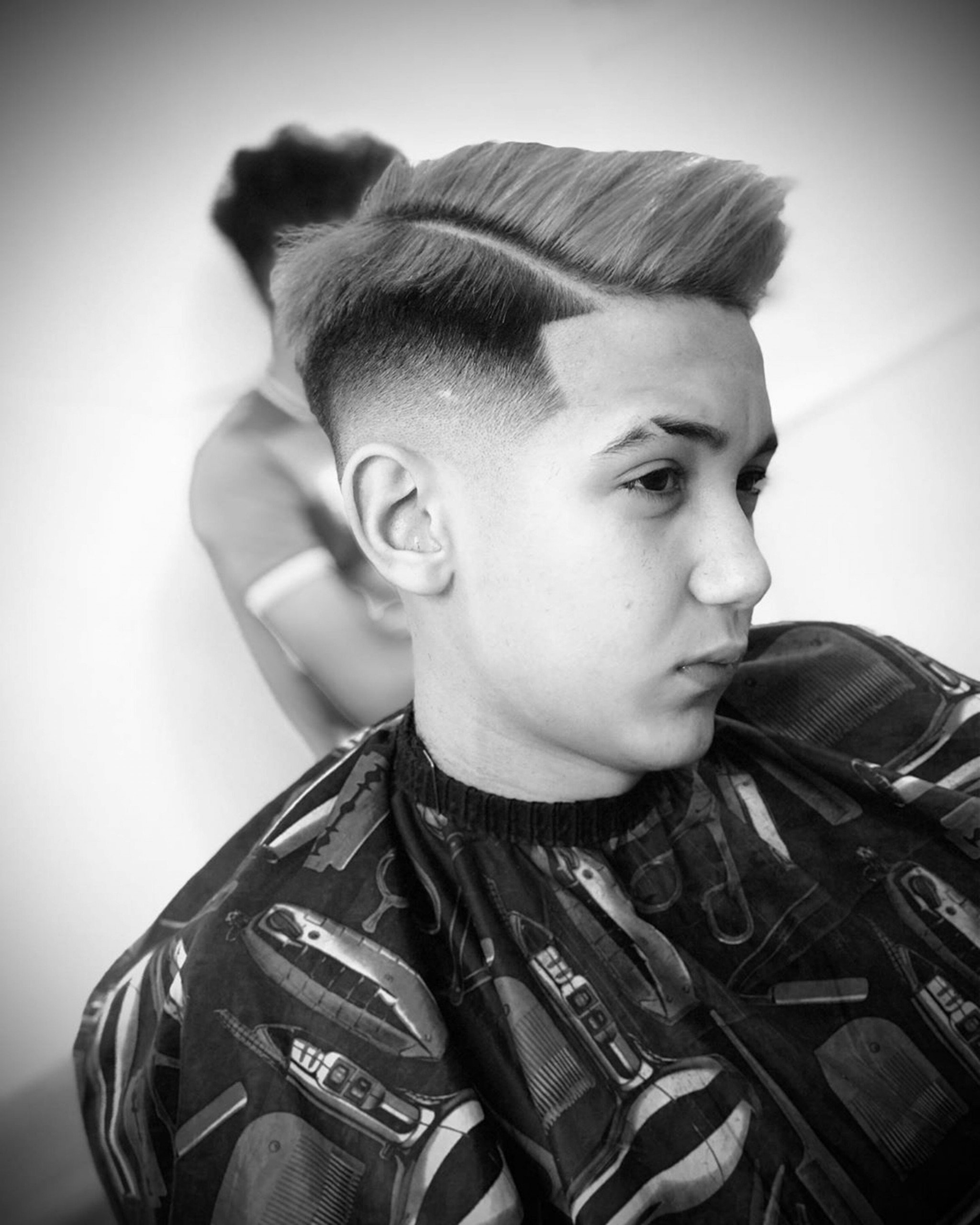 A middle-faded haircut for boys.