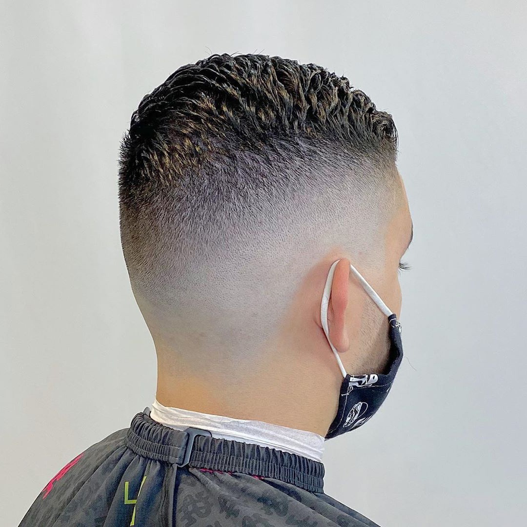 Guy from the back side view with a High Temp Fade Haircut.