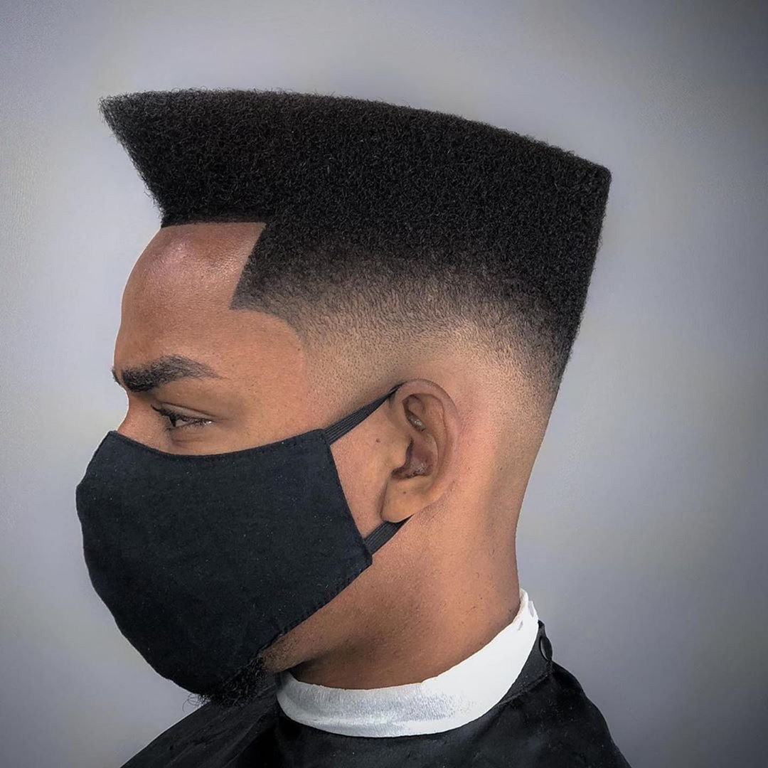 A black guy with a high top and a temp fade.