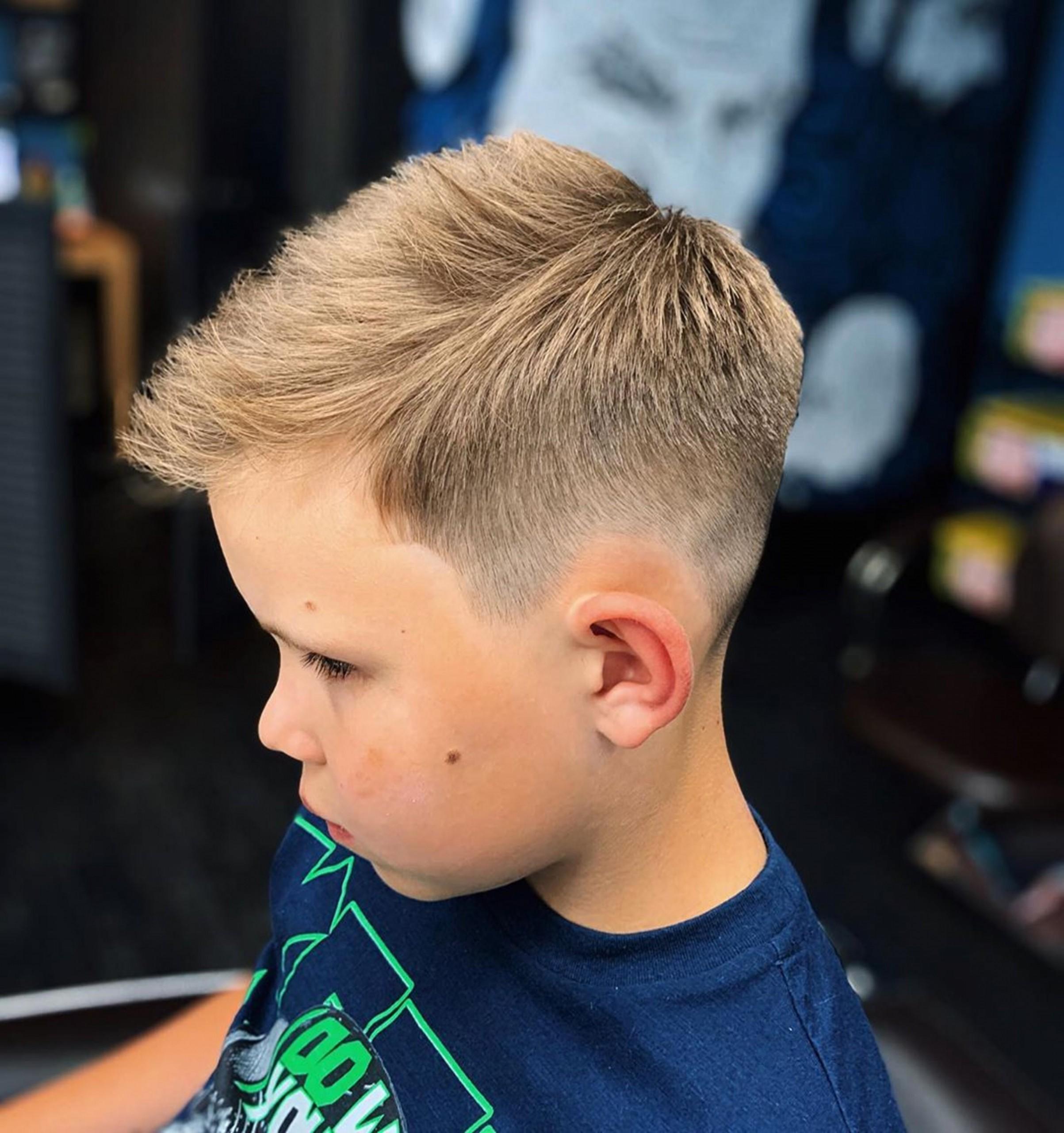 A fade haircut for little boys.