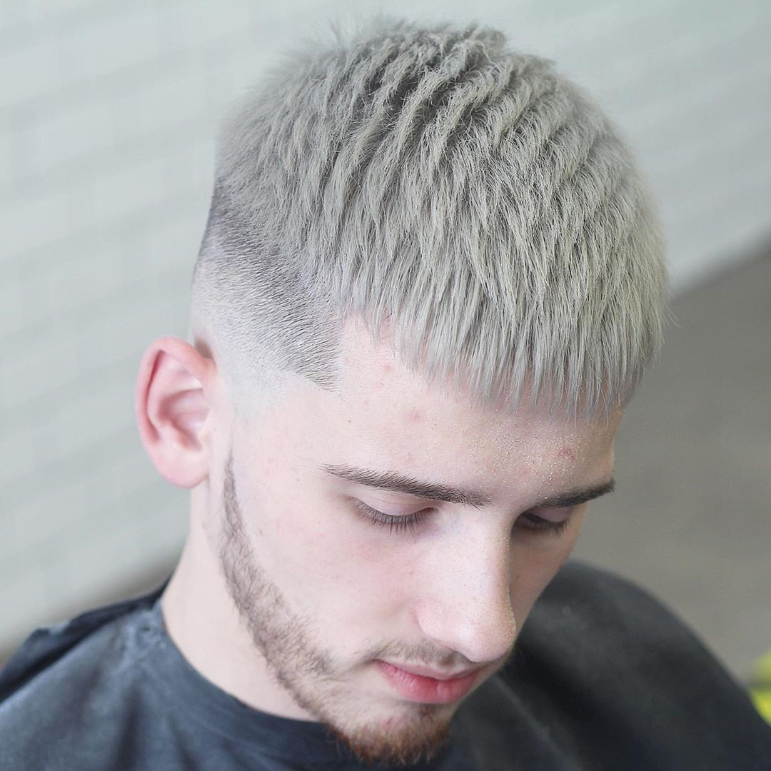 A blonde guy with a temp fade and a short hair crop hairstyle.