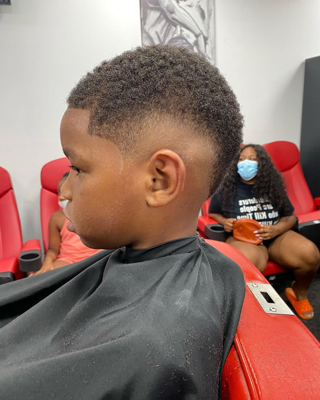 A young boy with a temp fade on toddler boy.