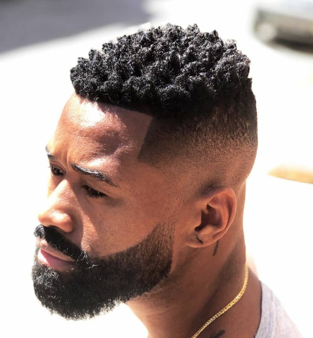 The picture of the man which answers the question: What Is a Temp Fade Haircut.