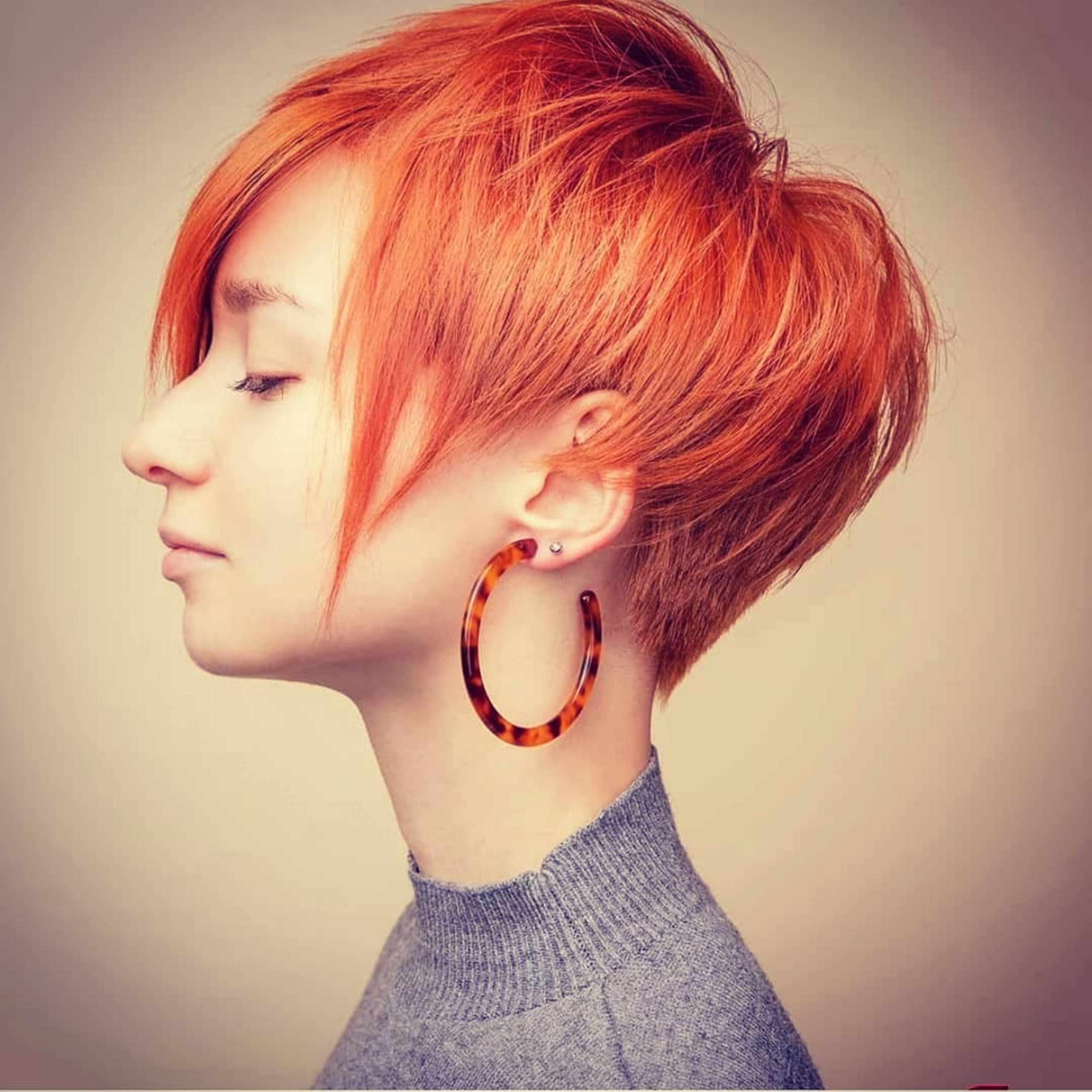 A pixie short haircut for red hair.