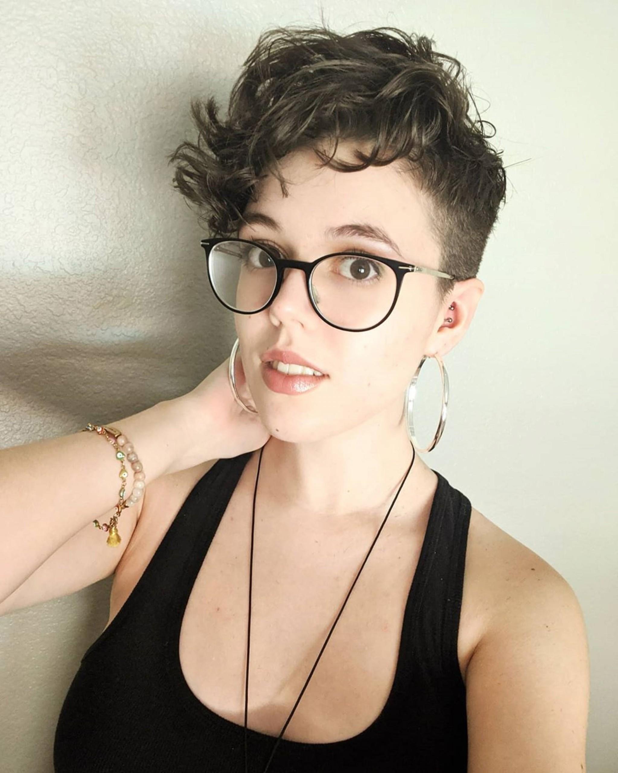 A pixie haircut for short wavy hair.