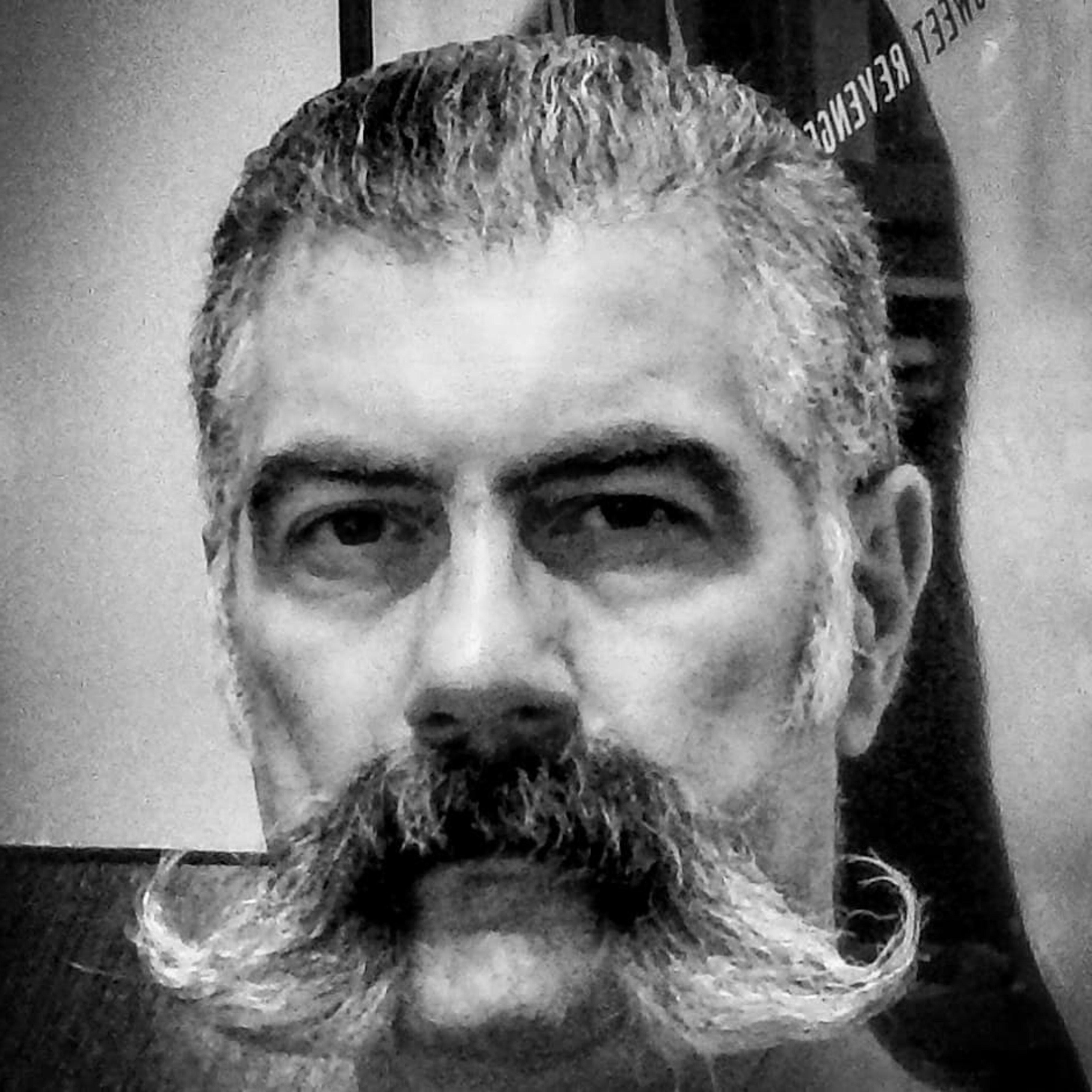 Handlebar mustache of 70s.