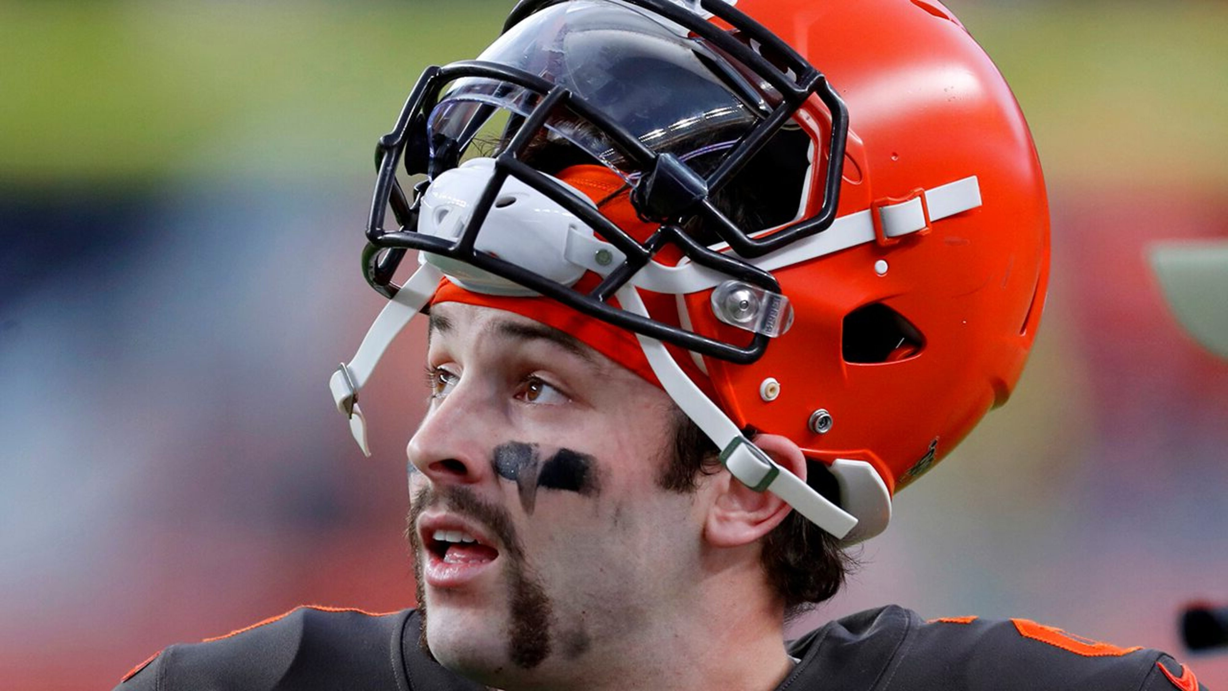 Handlebar mustache in the style of Baker Mayfield.