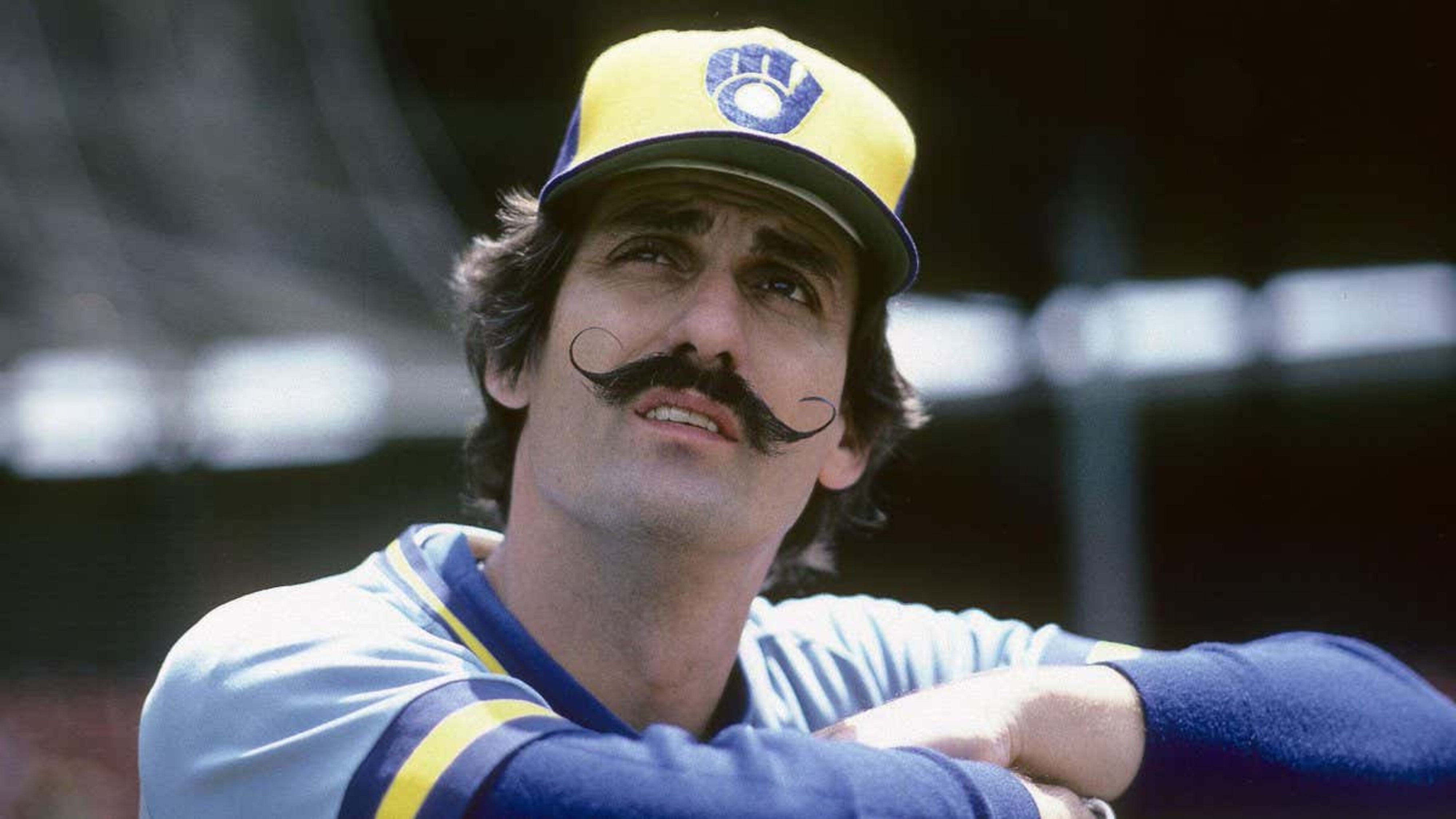 Baseball handlebar mustache for trendy look.