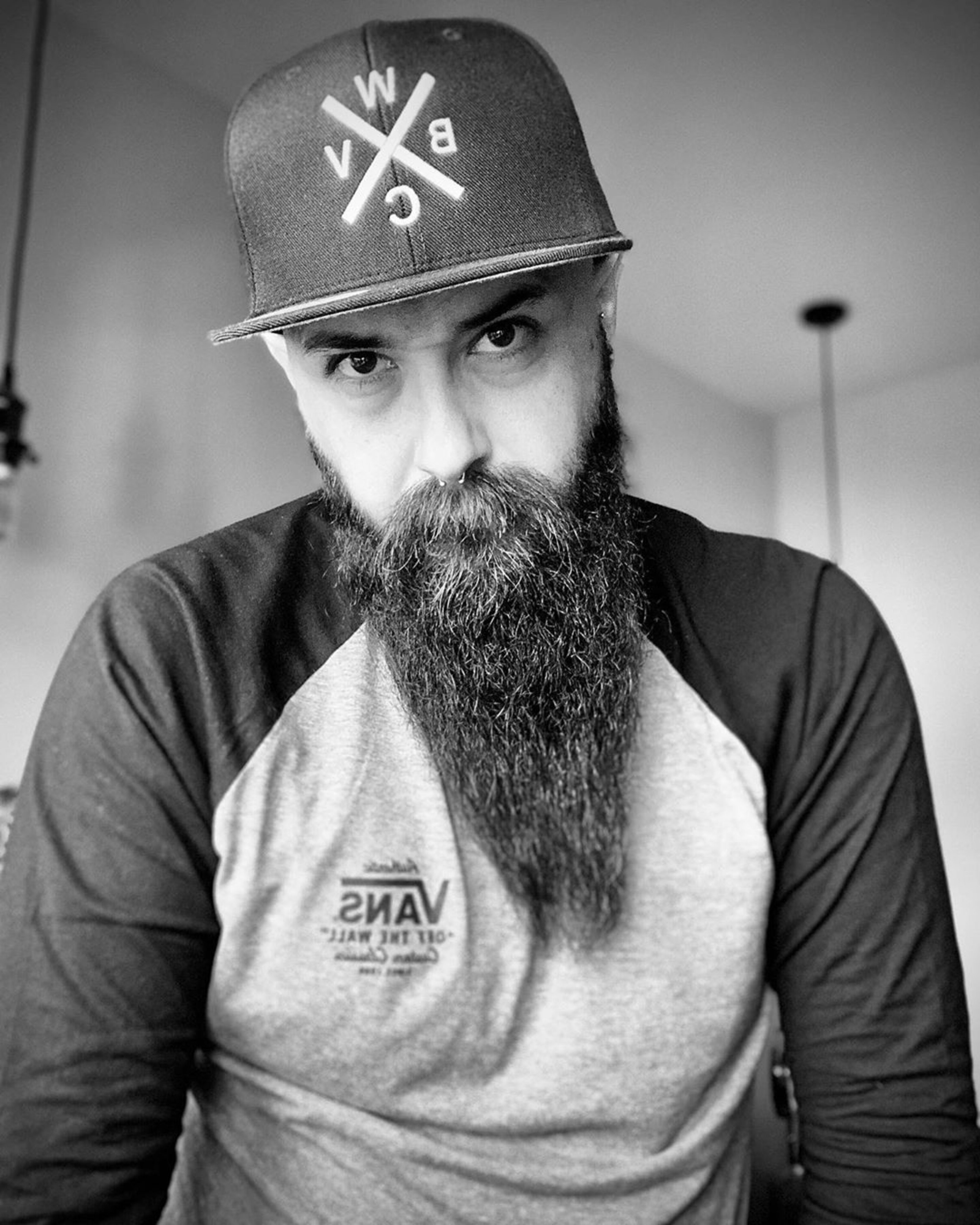 A beard shorter on sides and longer on chin.