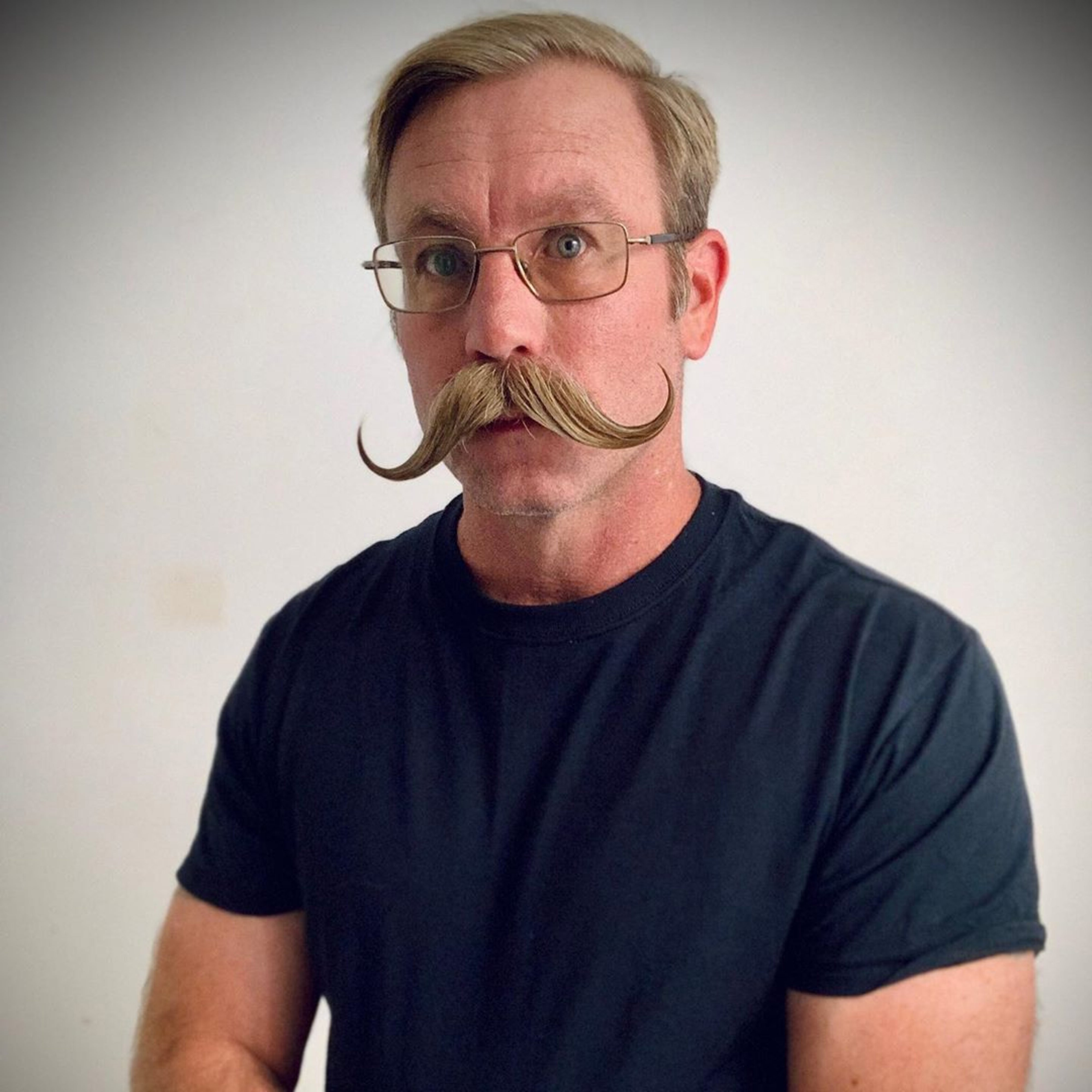 The biggest handlebar mustache for men.