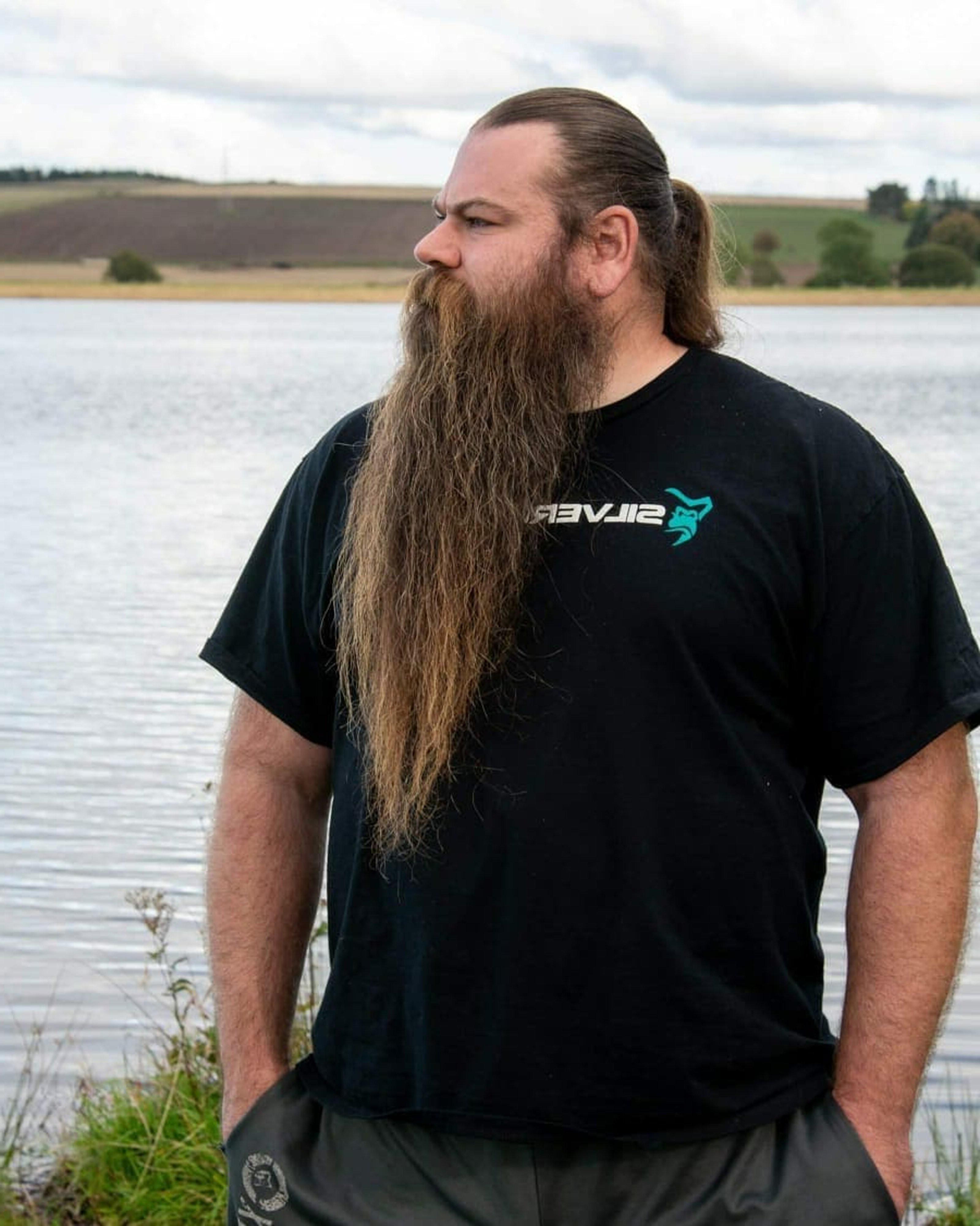 A long beard in the biker style.