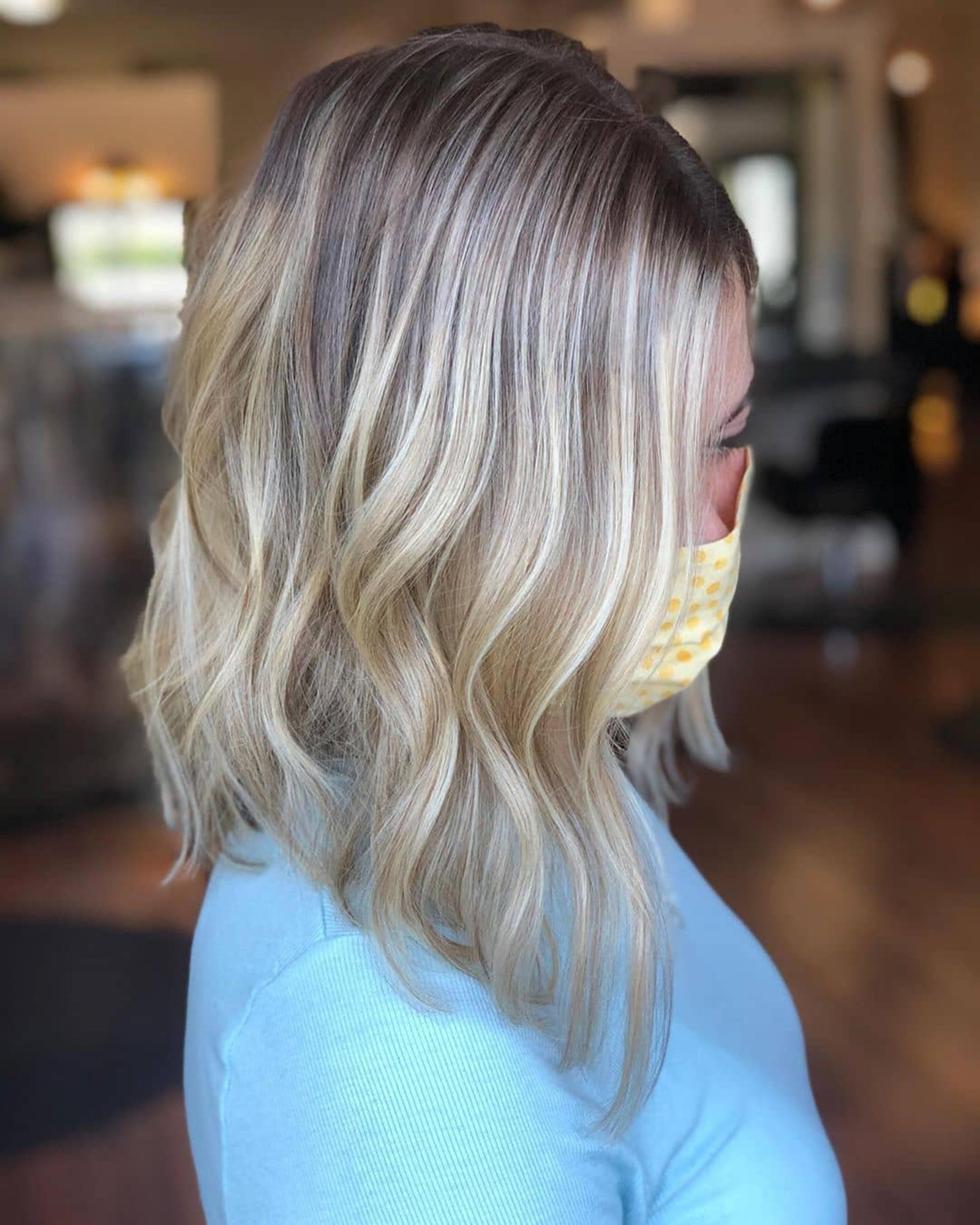 A layered bob of blonde balayage color.