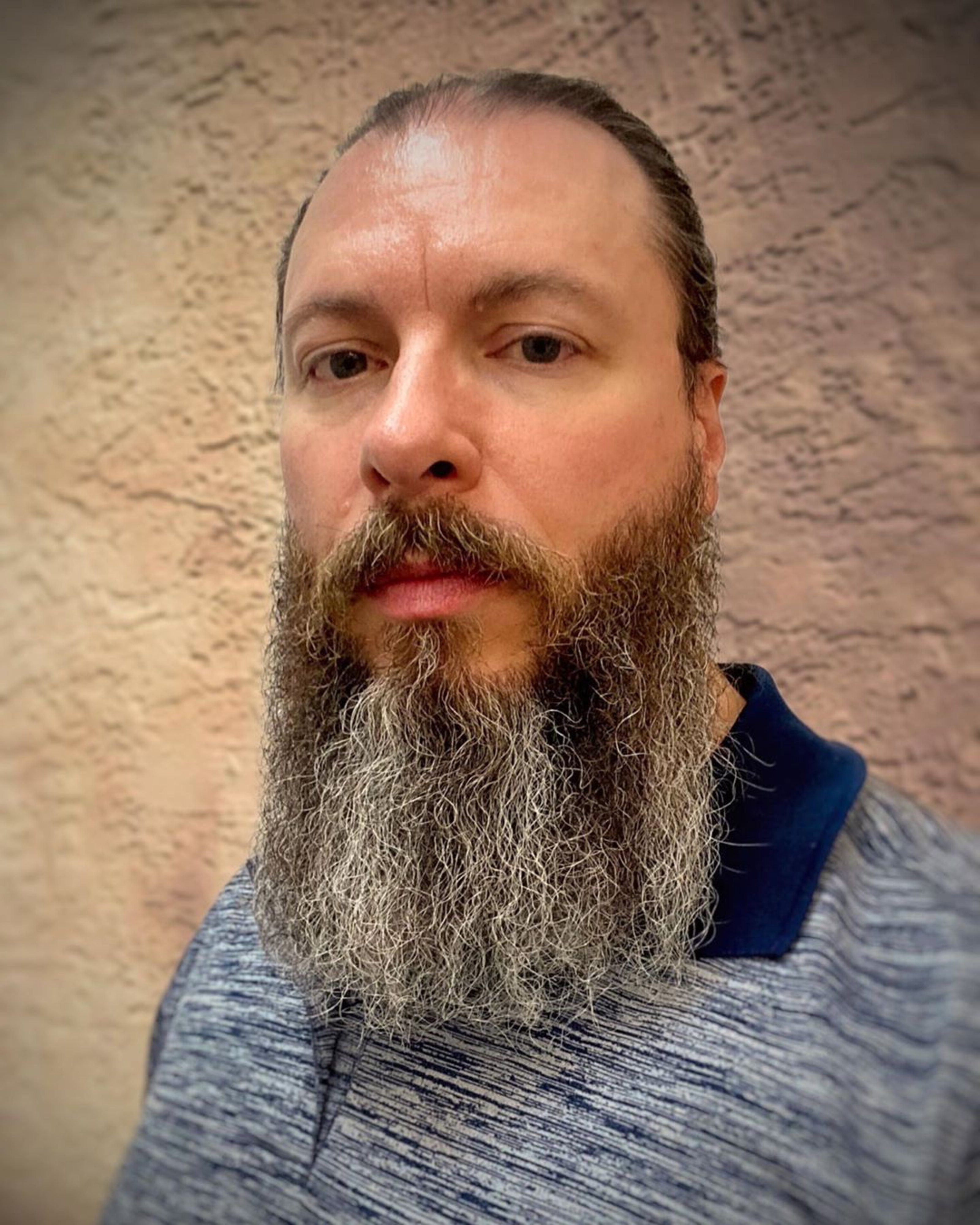A long bearded style with a buzz cut.