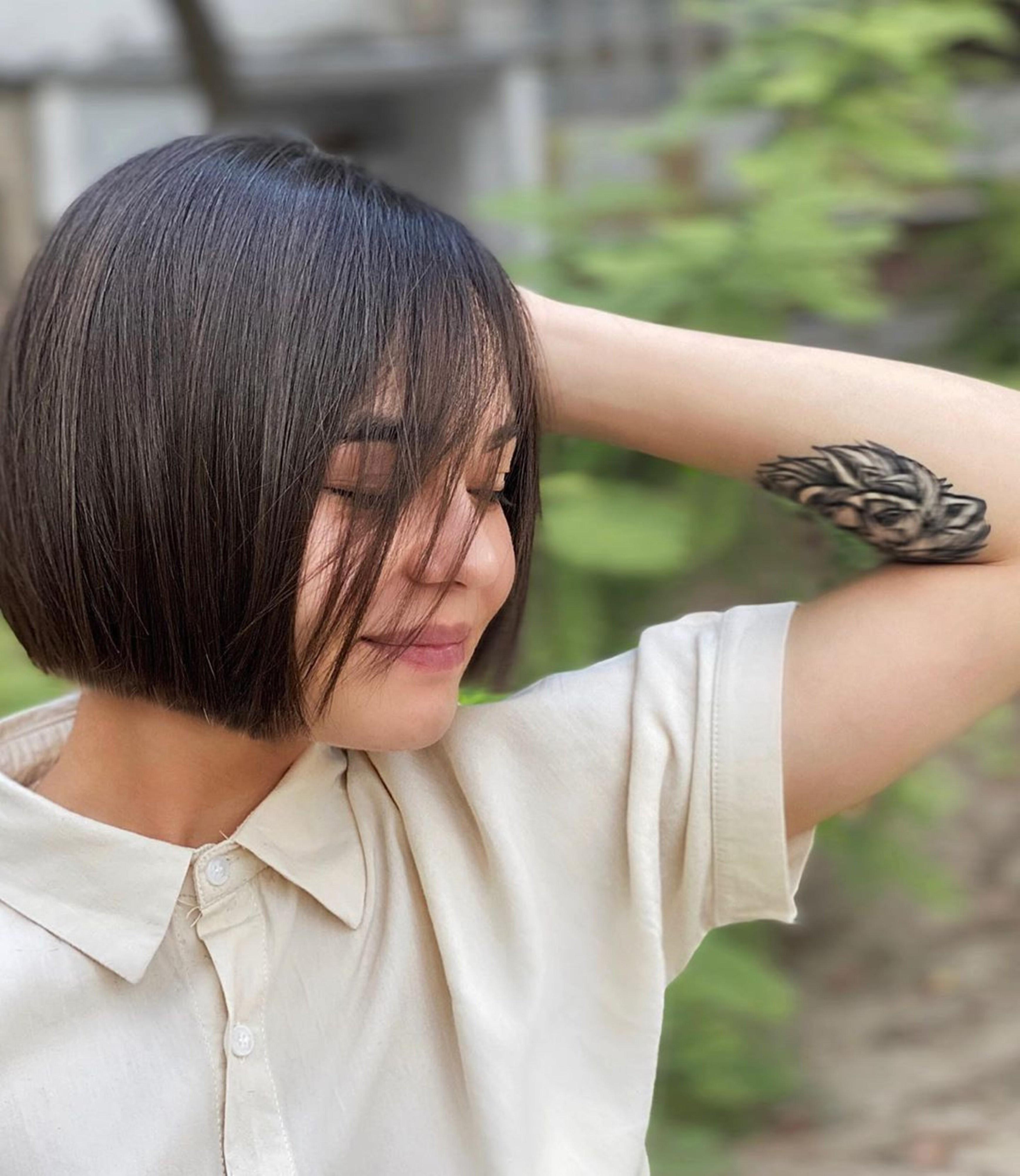 Chin-length bob hair cut.