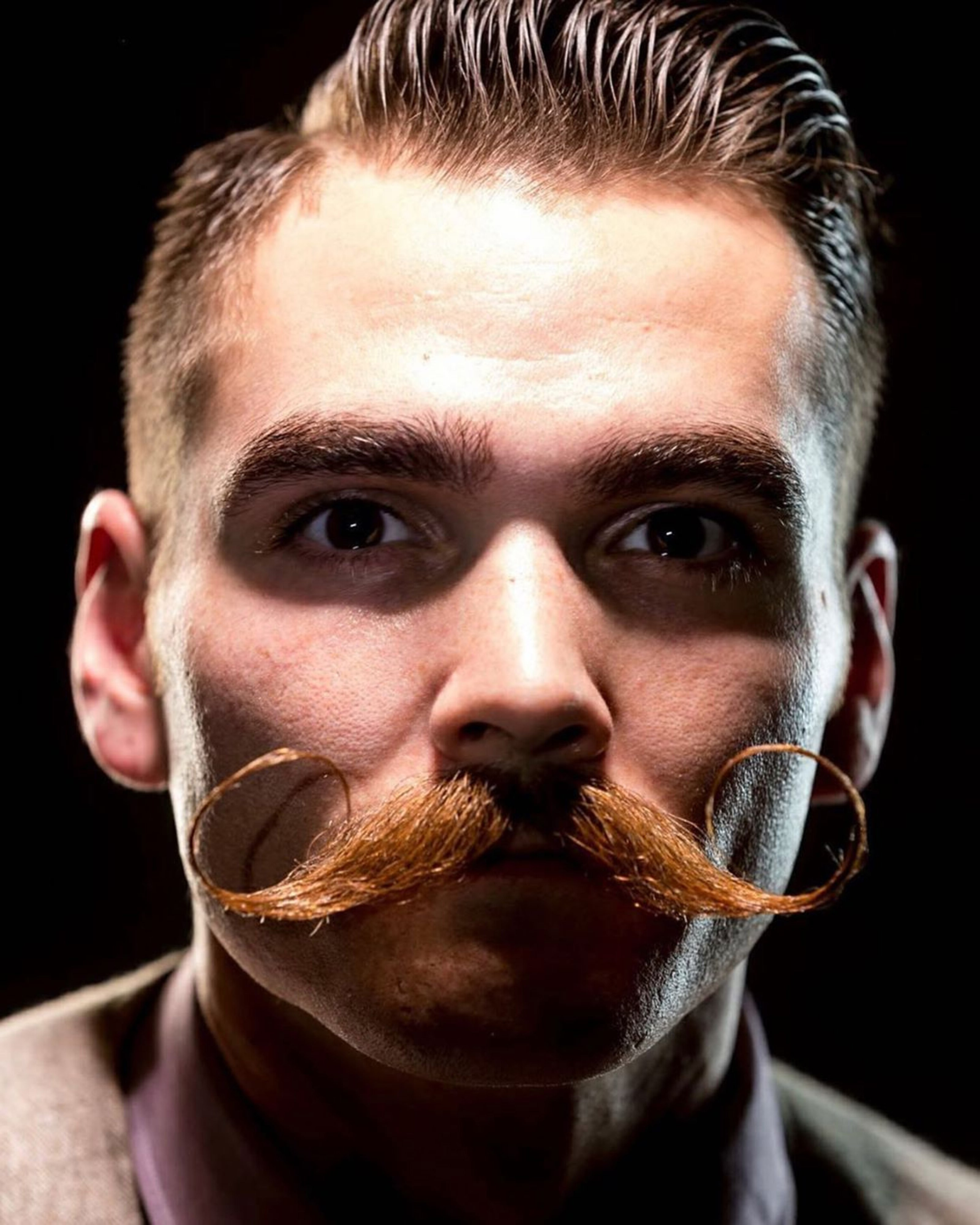 Emilio handlebar mustache for self-confident men.