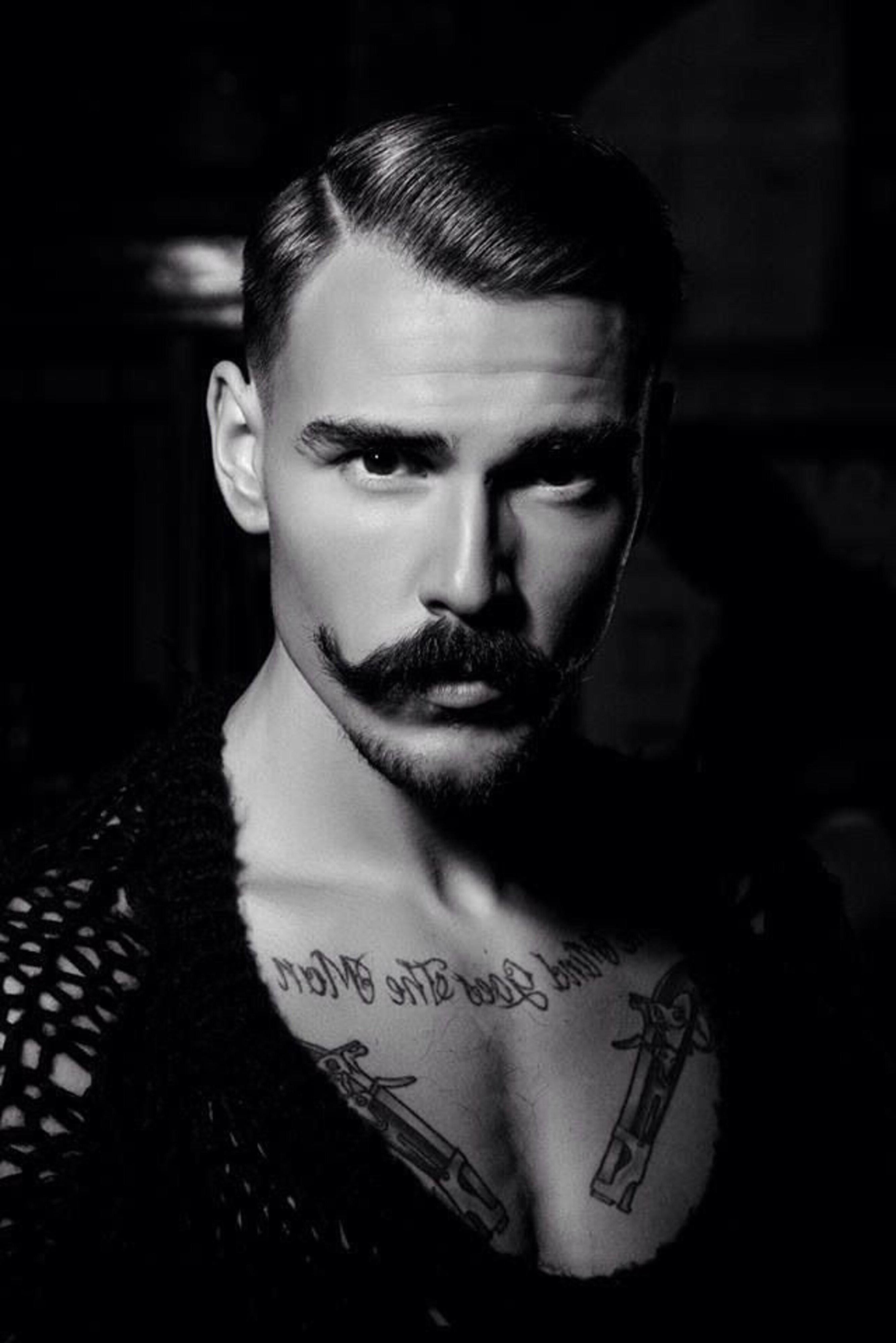 Freddie Mercury's style with handlebar mustache.