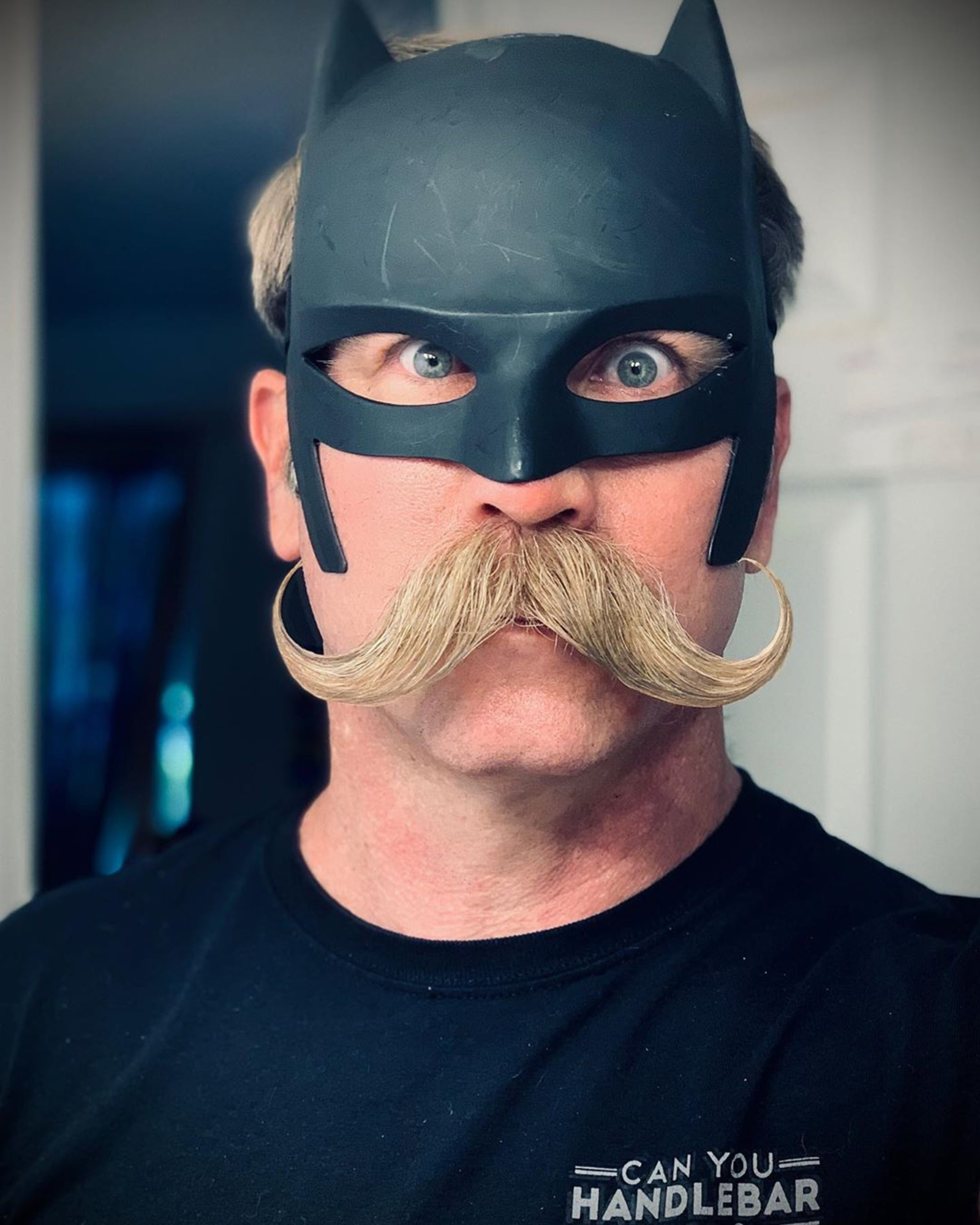A funny handlebar mustache for males.