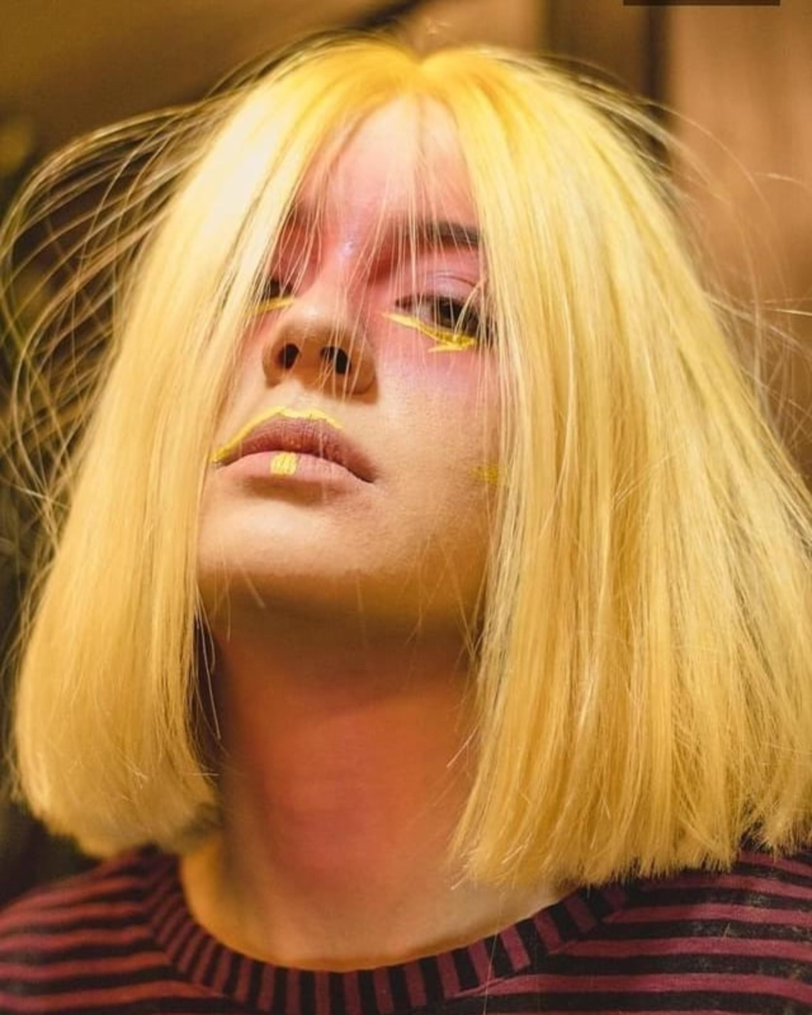 A golden blonde bob haircut.