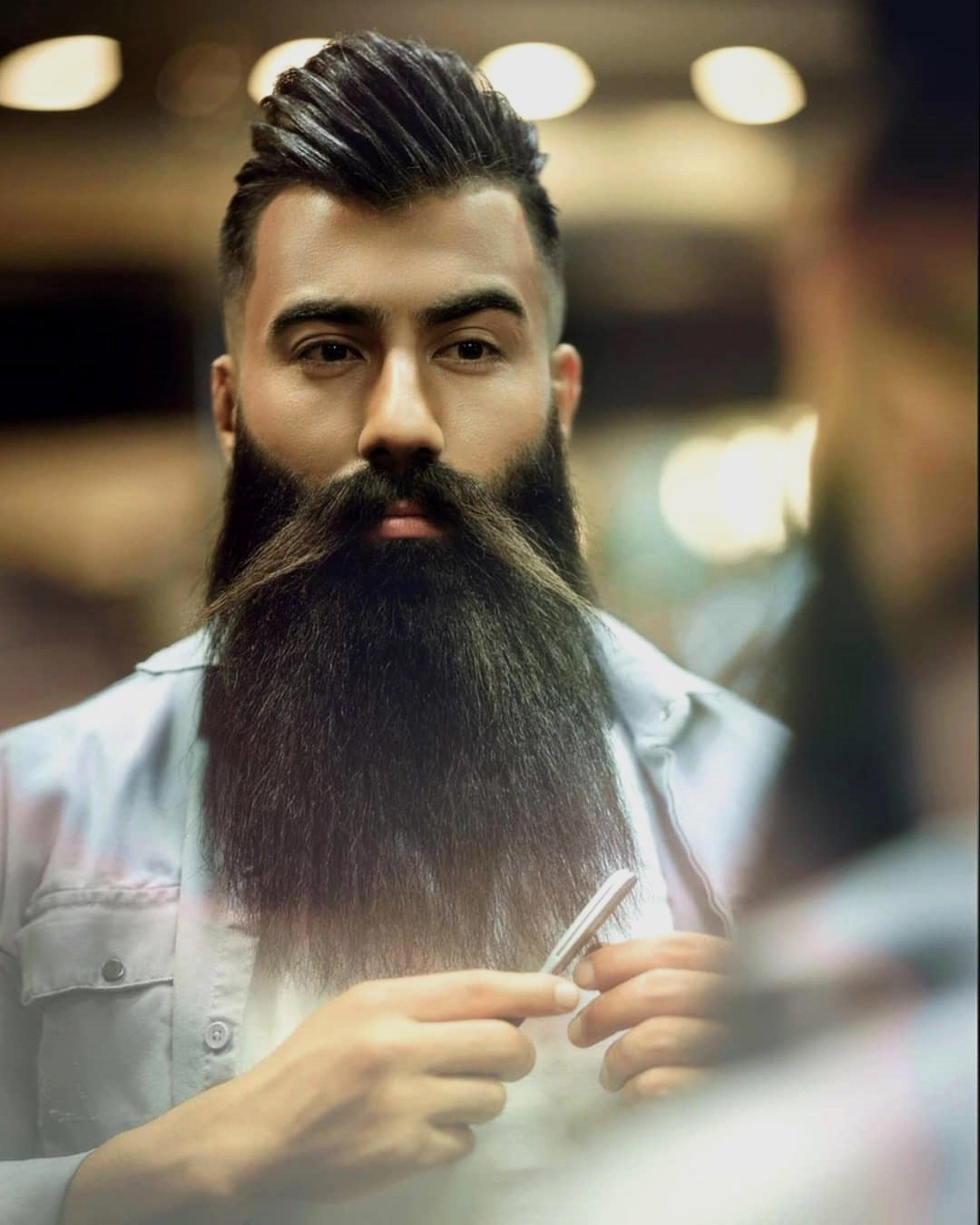 A long beard look for fashionable guys.