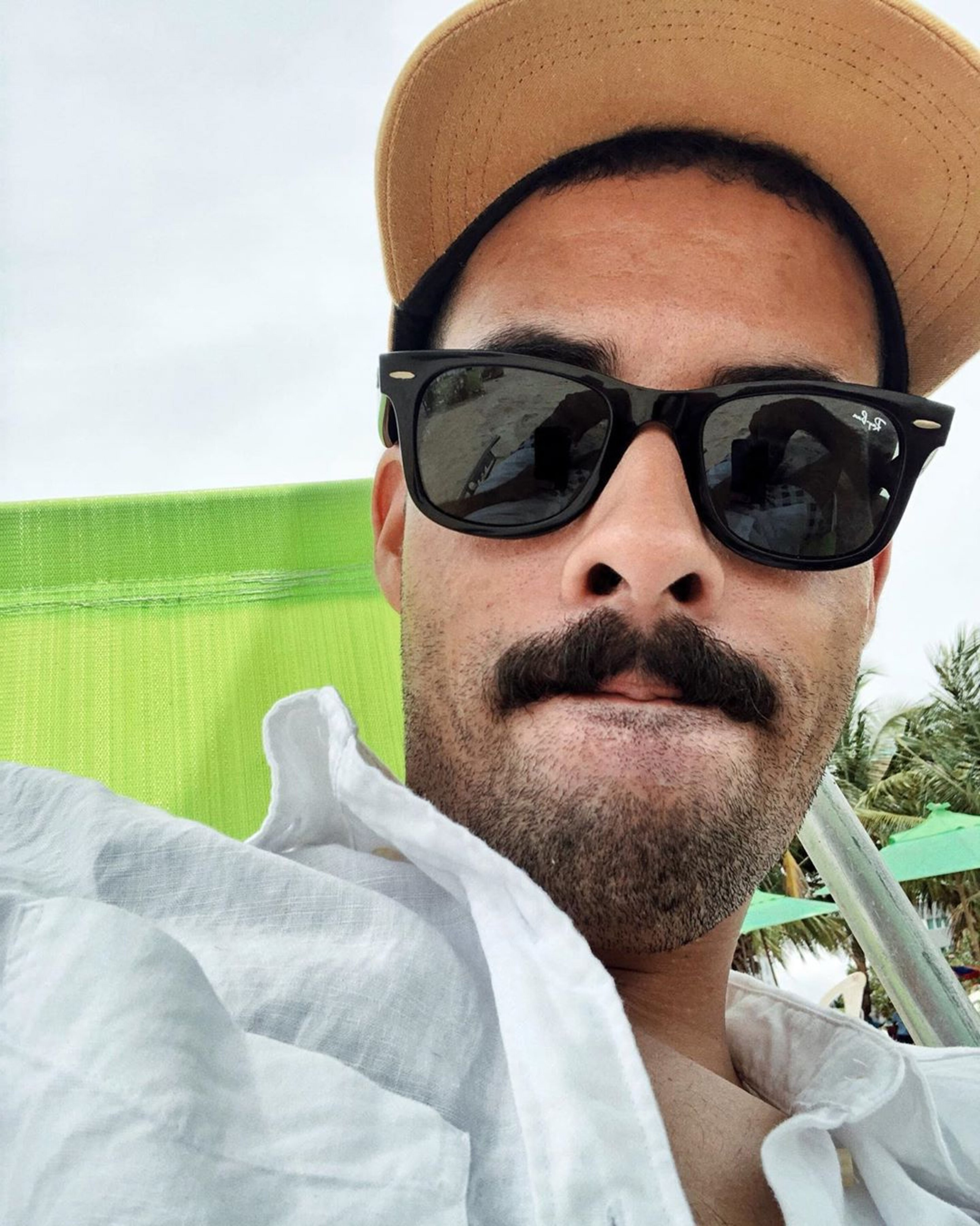 Italian handlebar mustache for stylish males.