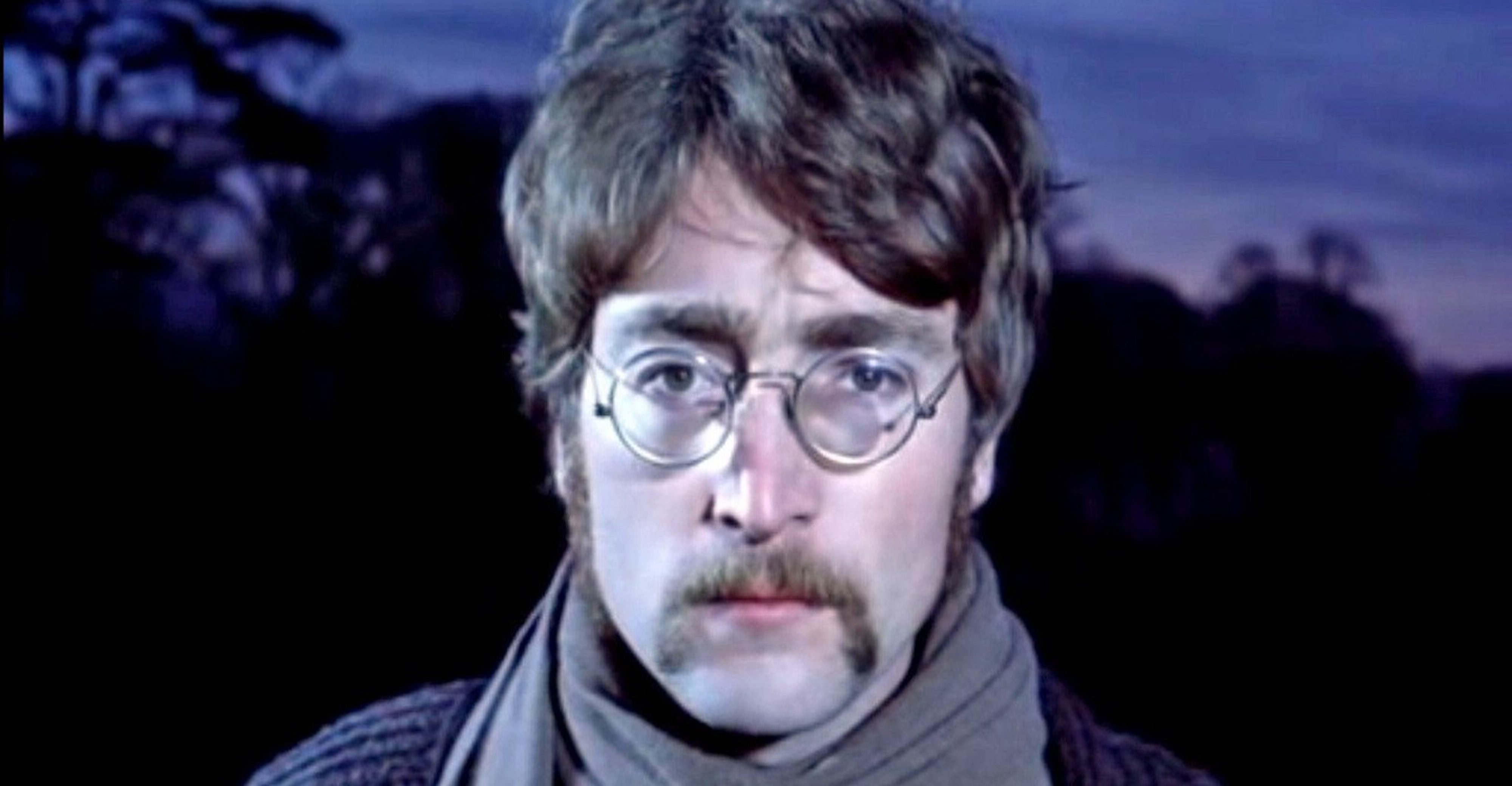 Handlebar mustache in the style of John Lennon.