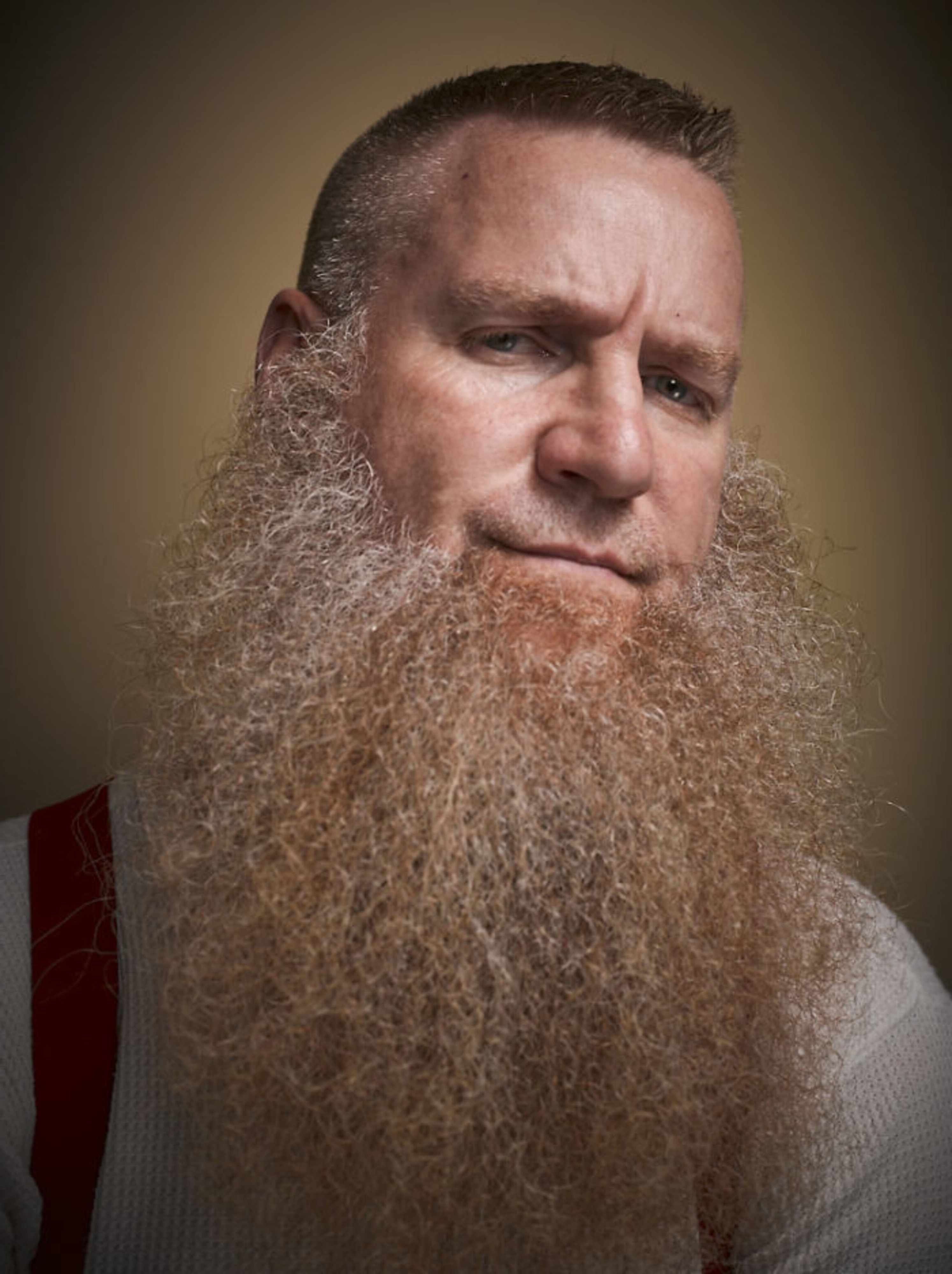 A long beard look without a mustache.