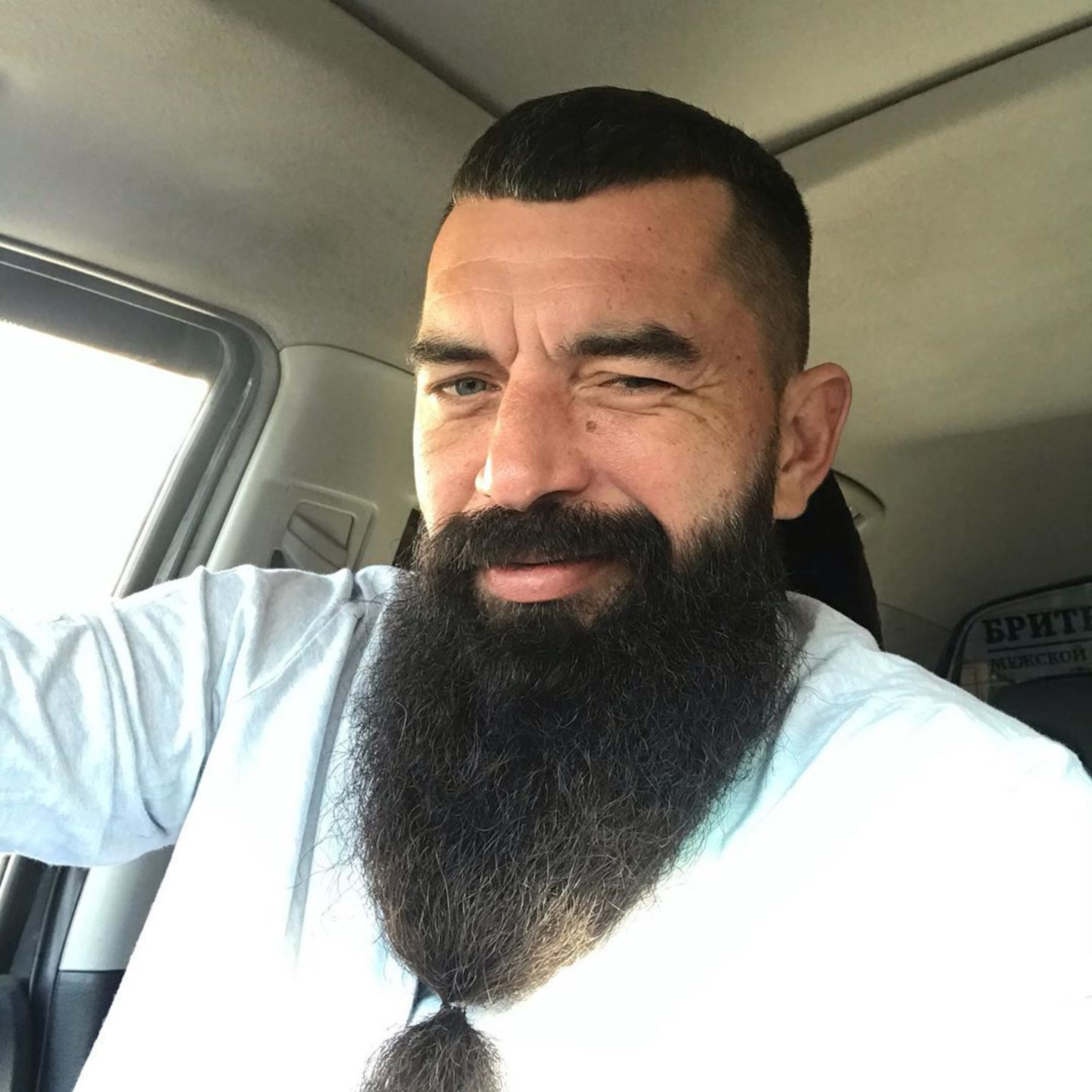 A long beard style with mustache for men.