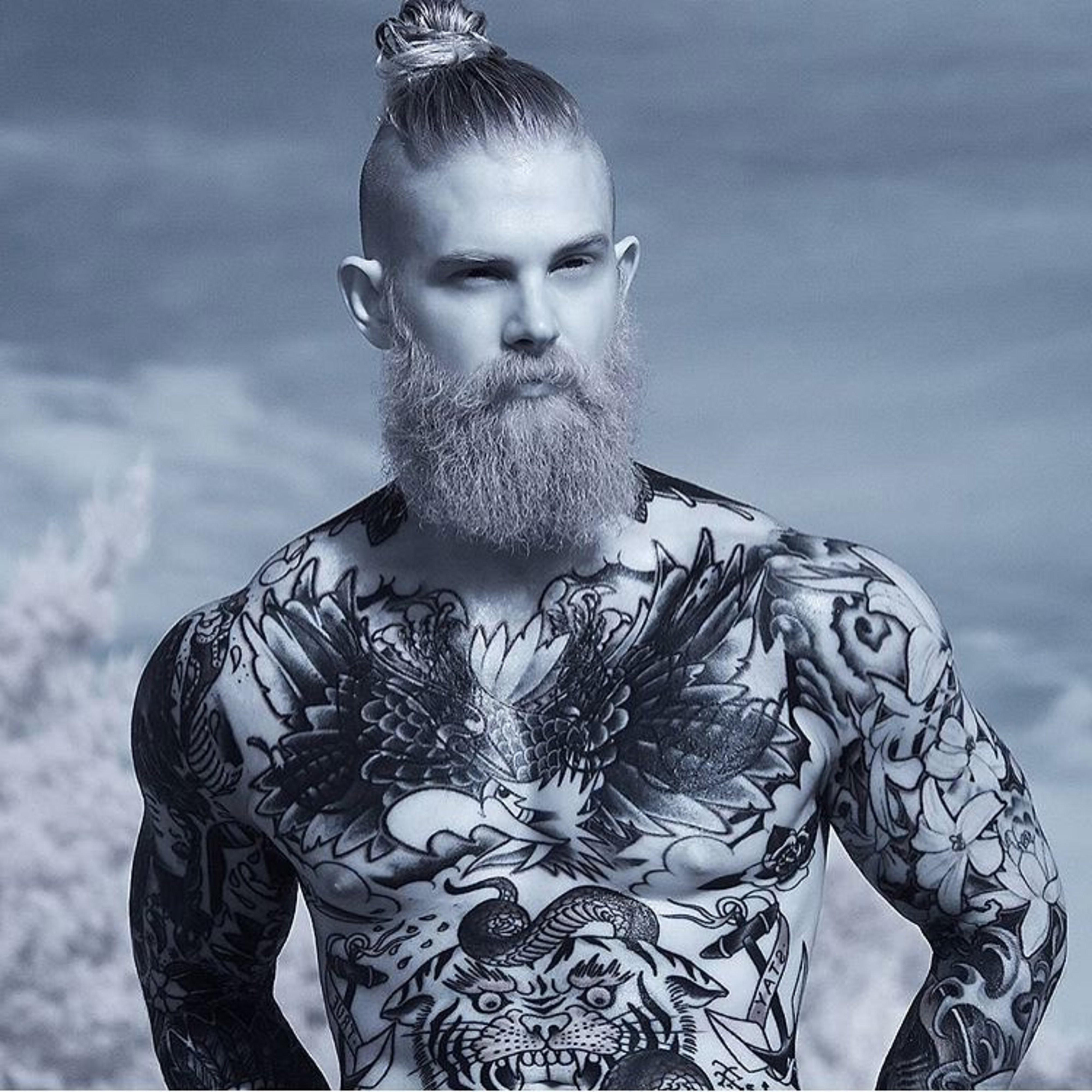 A long beard with a bun style.