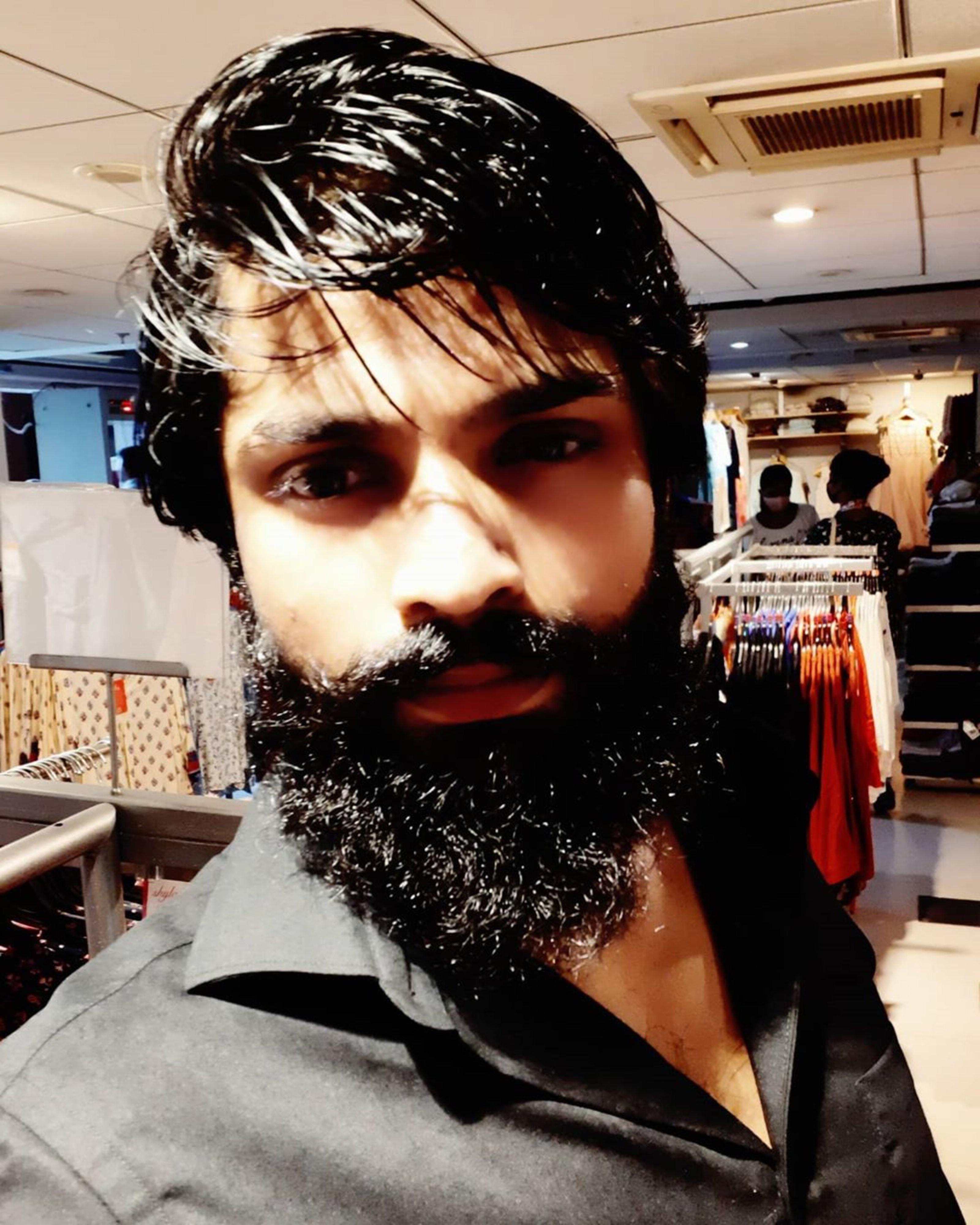 A long curled beard style.