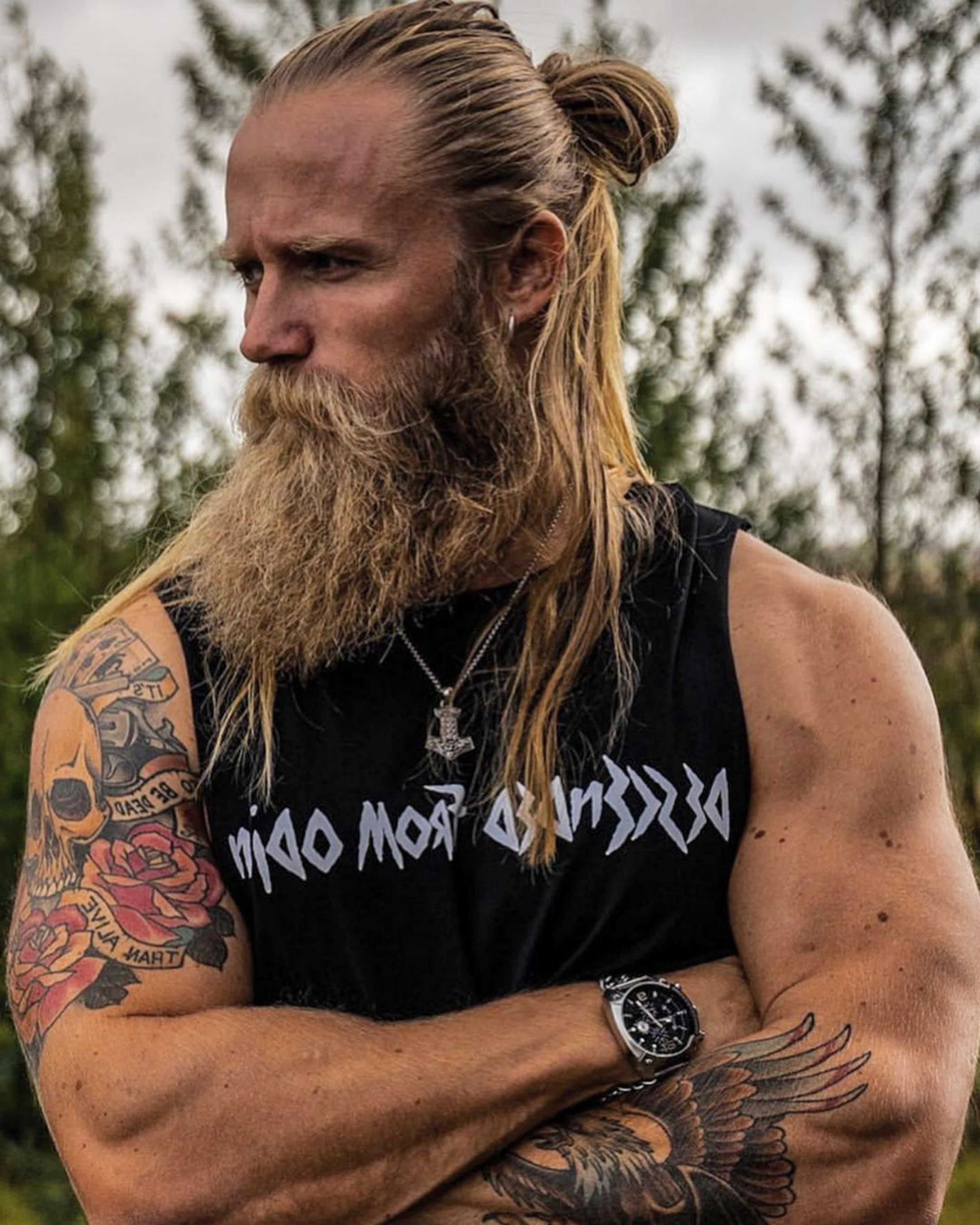 A lengthy hair style with a long beard.