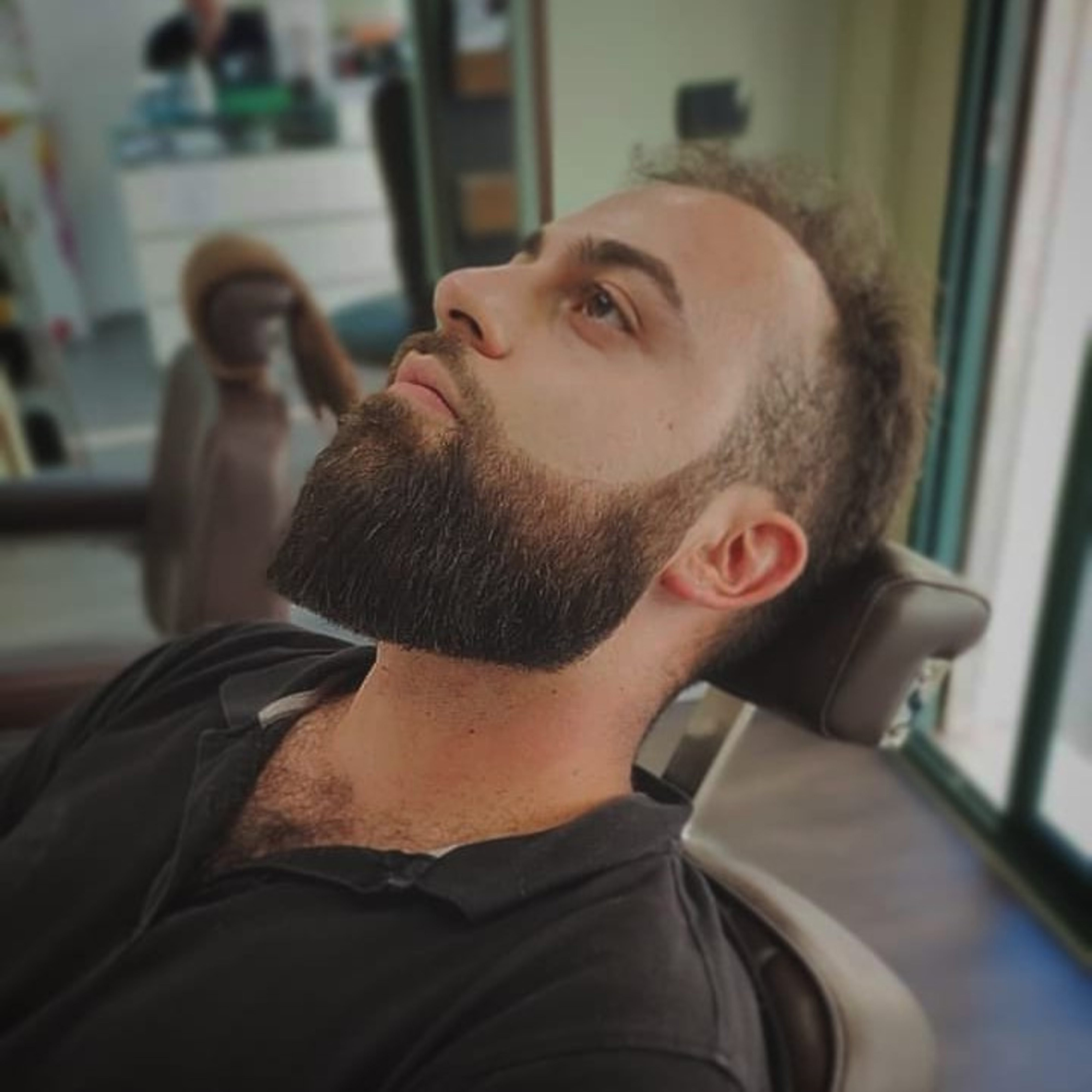 A long jawline beard style for cool men.