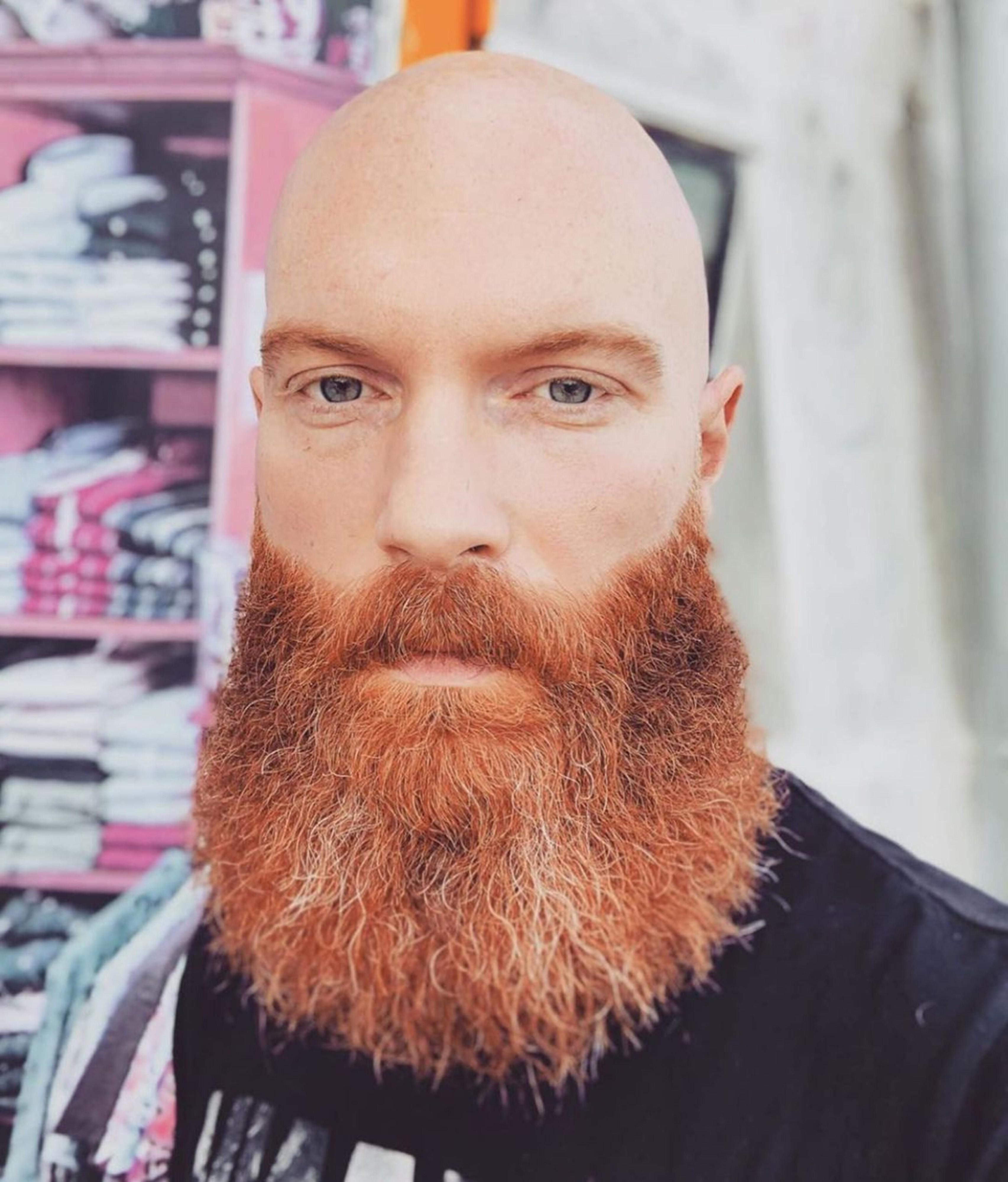 A long beard of the orange color.
