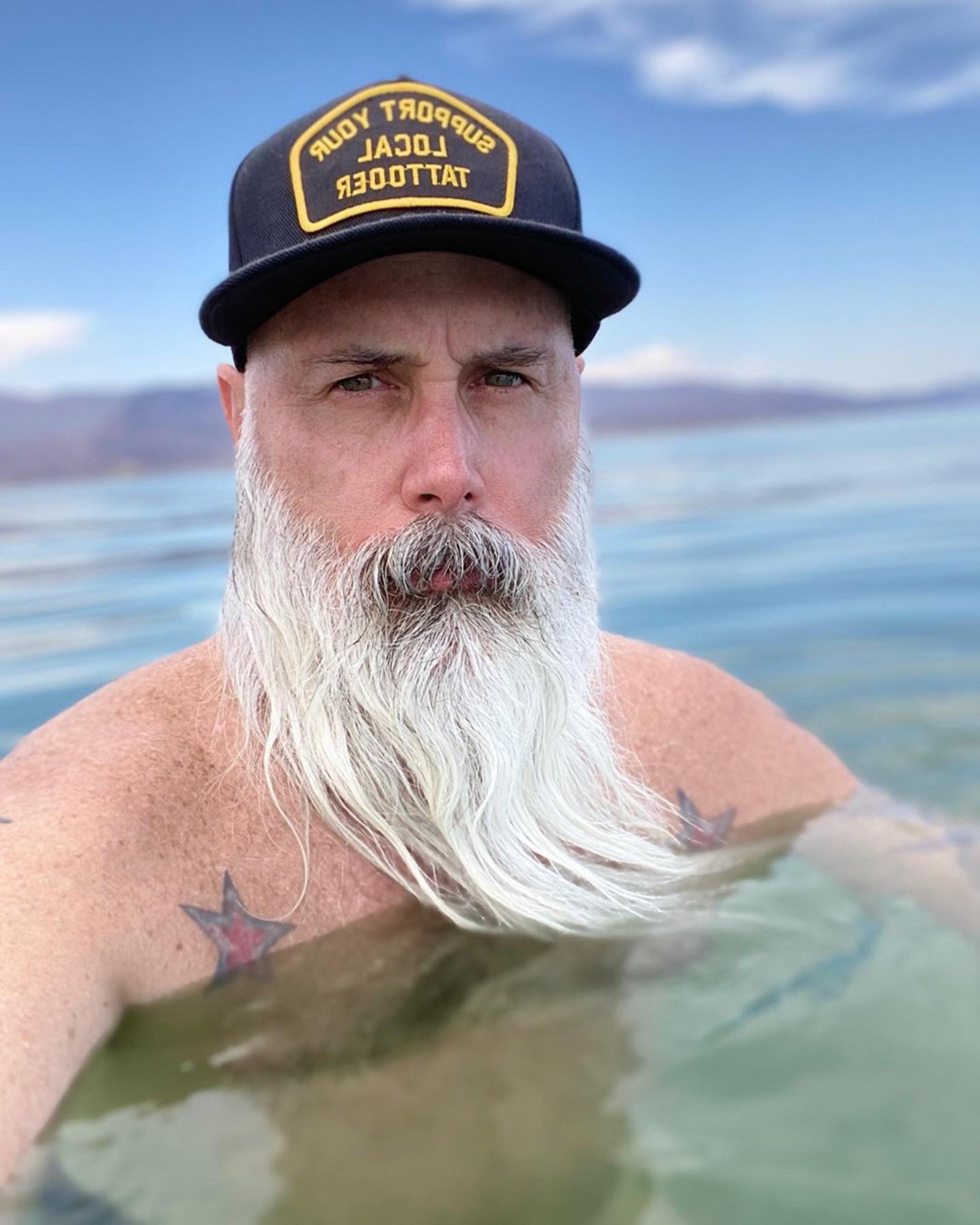 A long skinny beard look for stylish men.