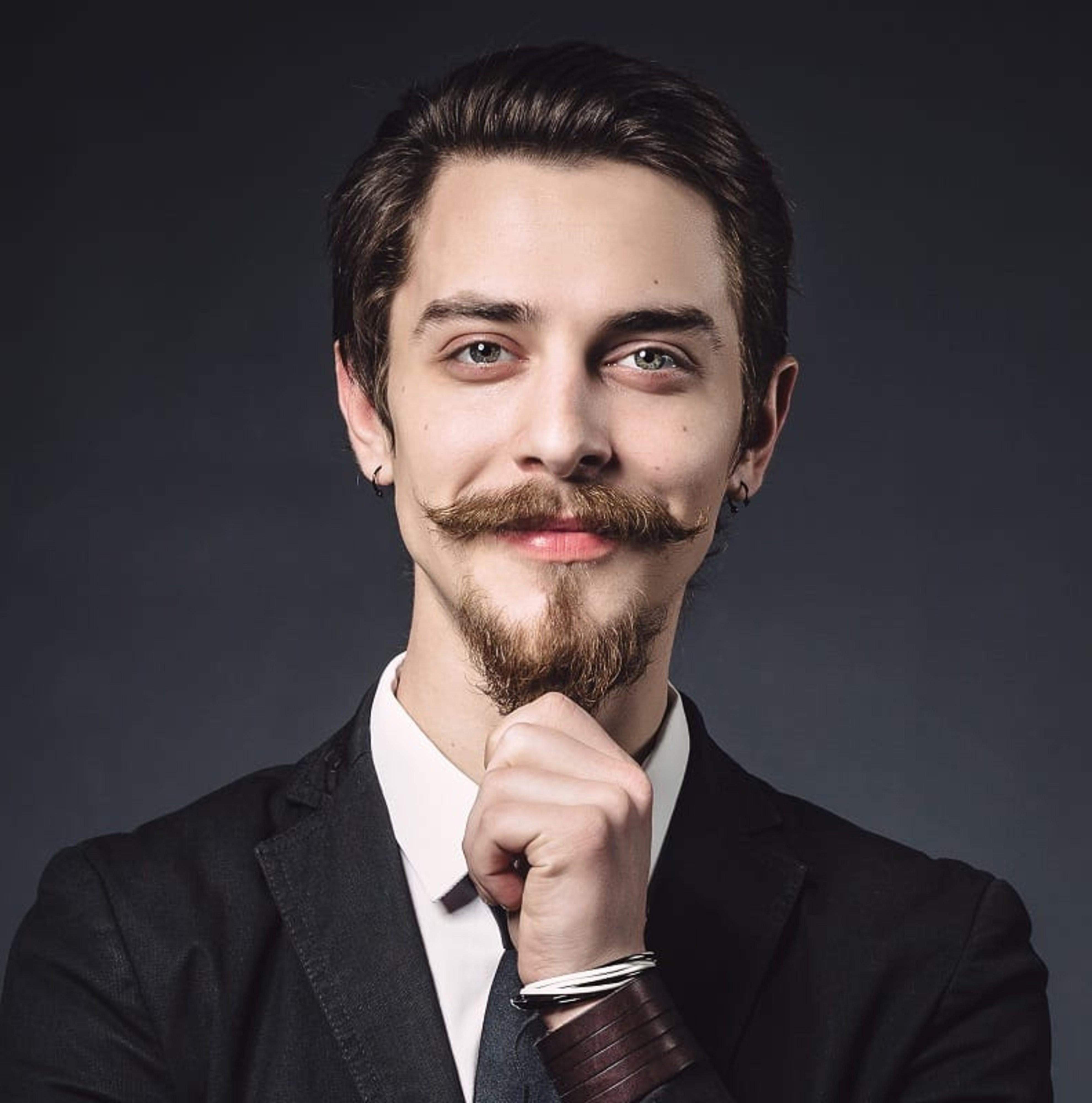 A long beard like Van Dyke has.