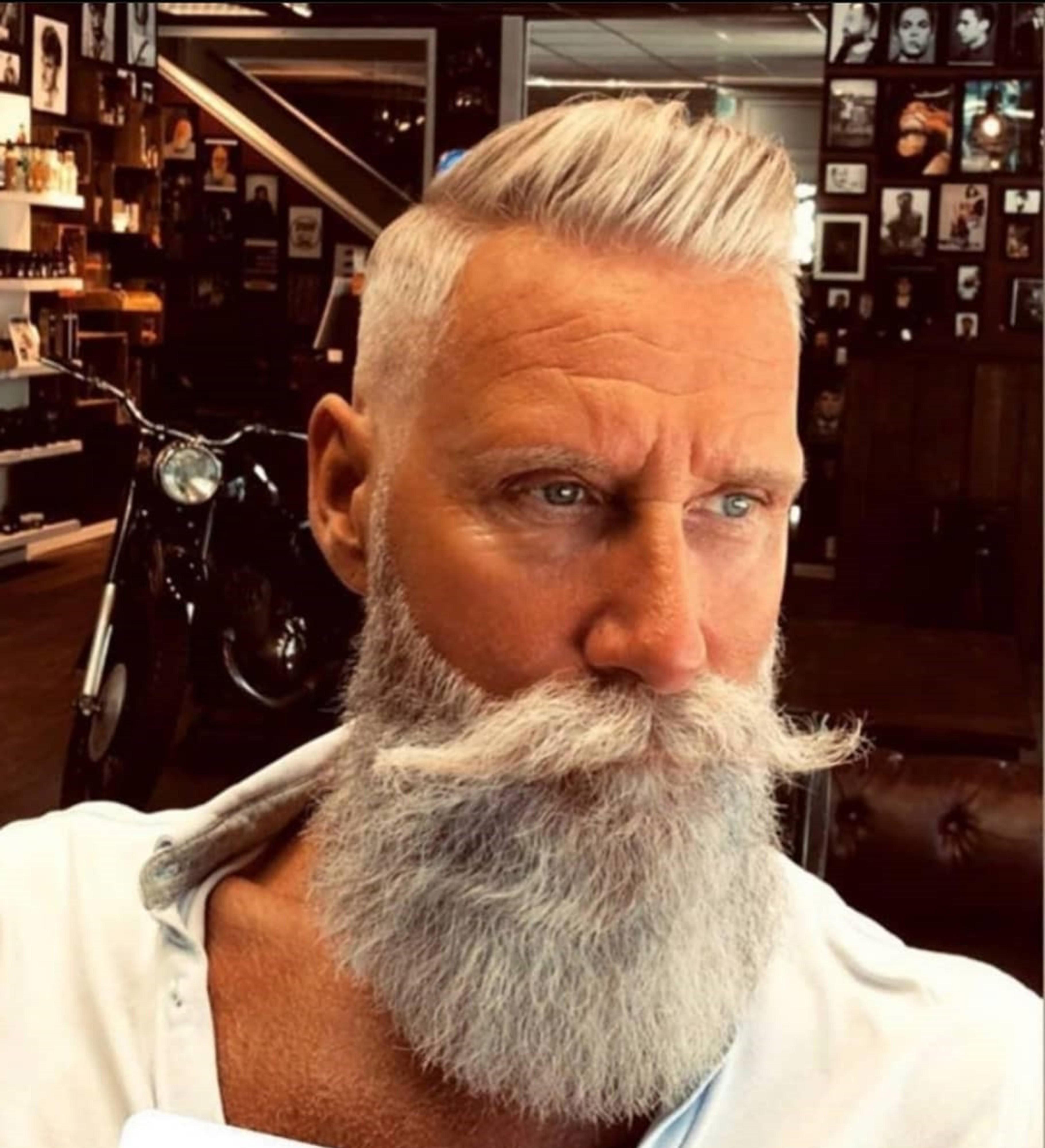 A long Verdi beard style for males.