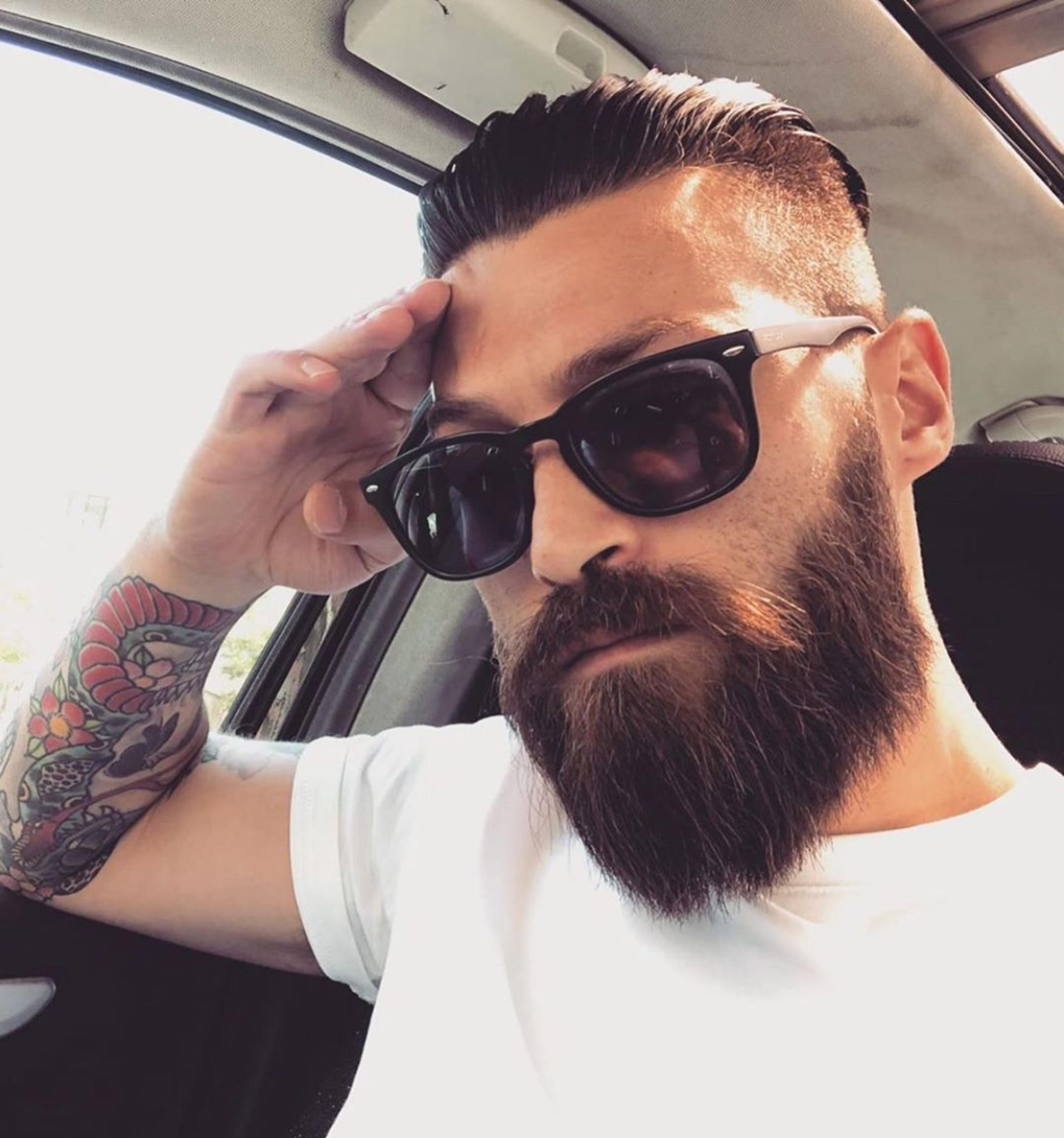 A mid hair look with a long beard.