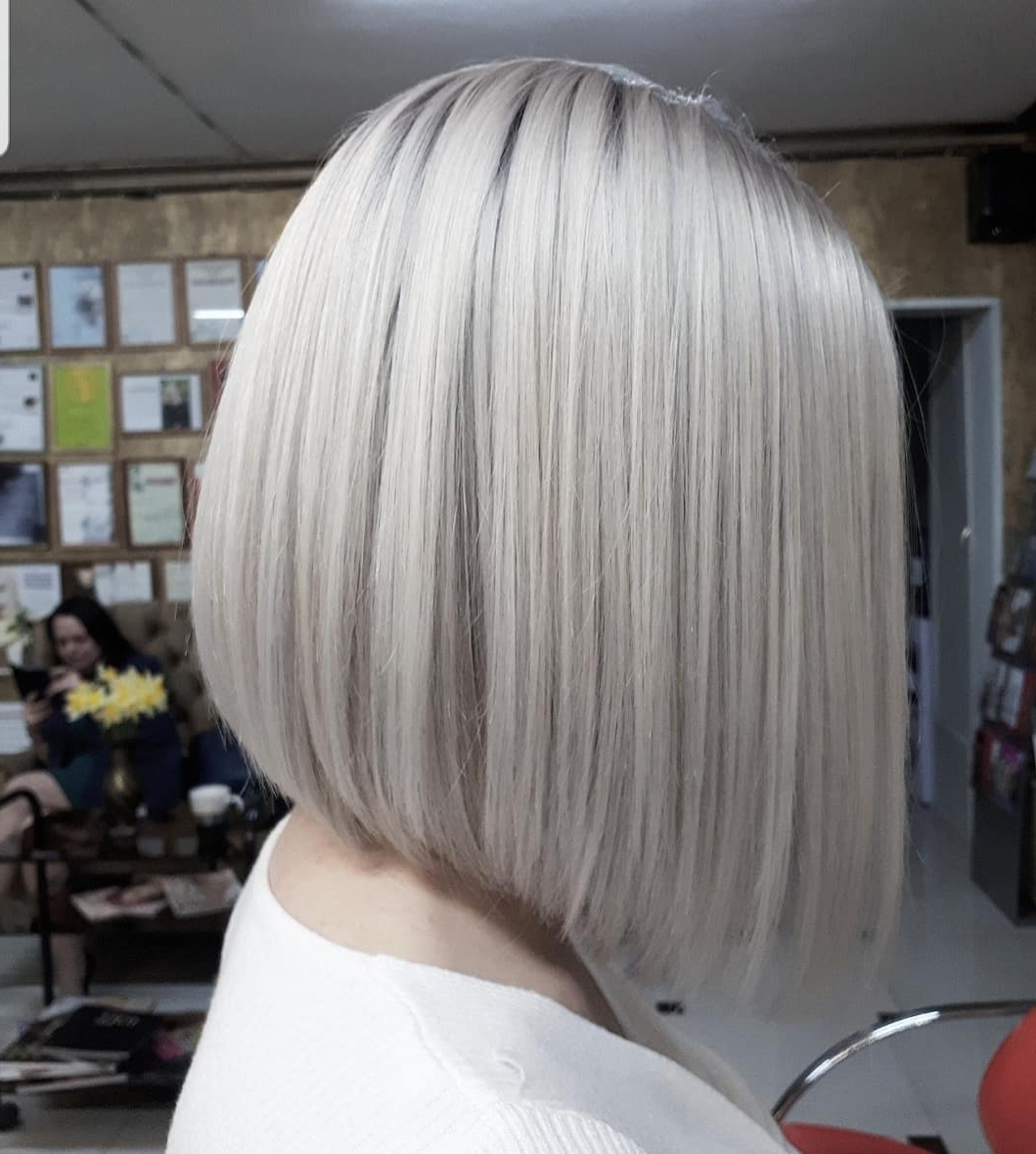 A metallic blonde bob haircut.