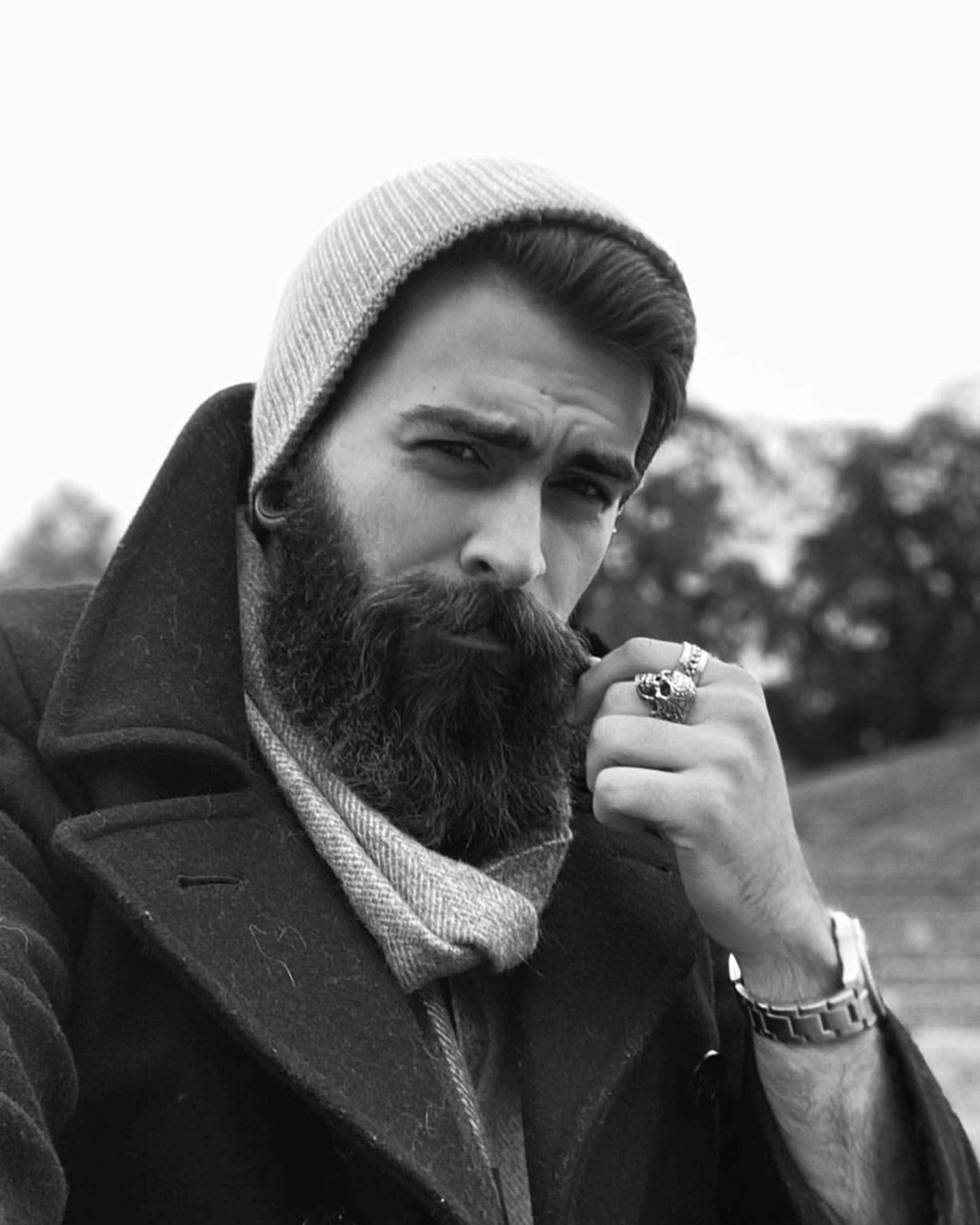 A long neat beard male look.