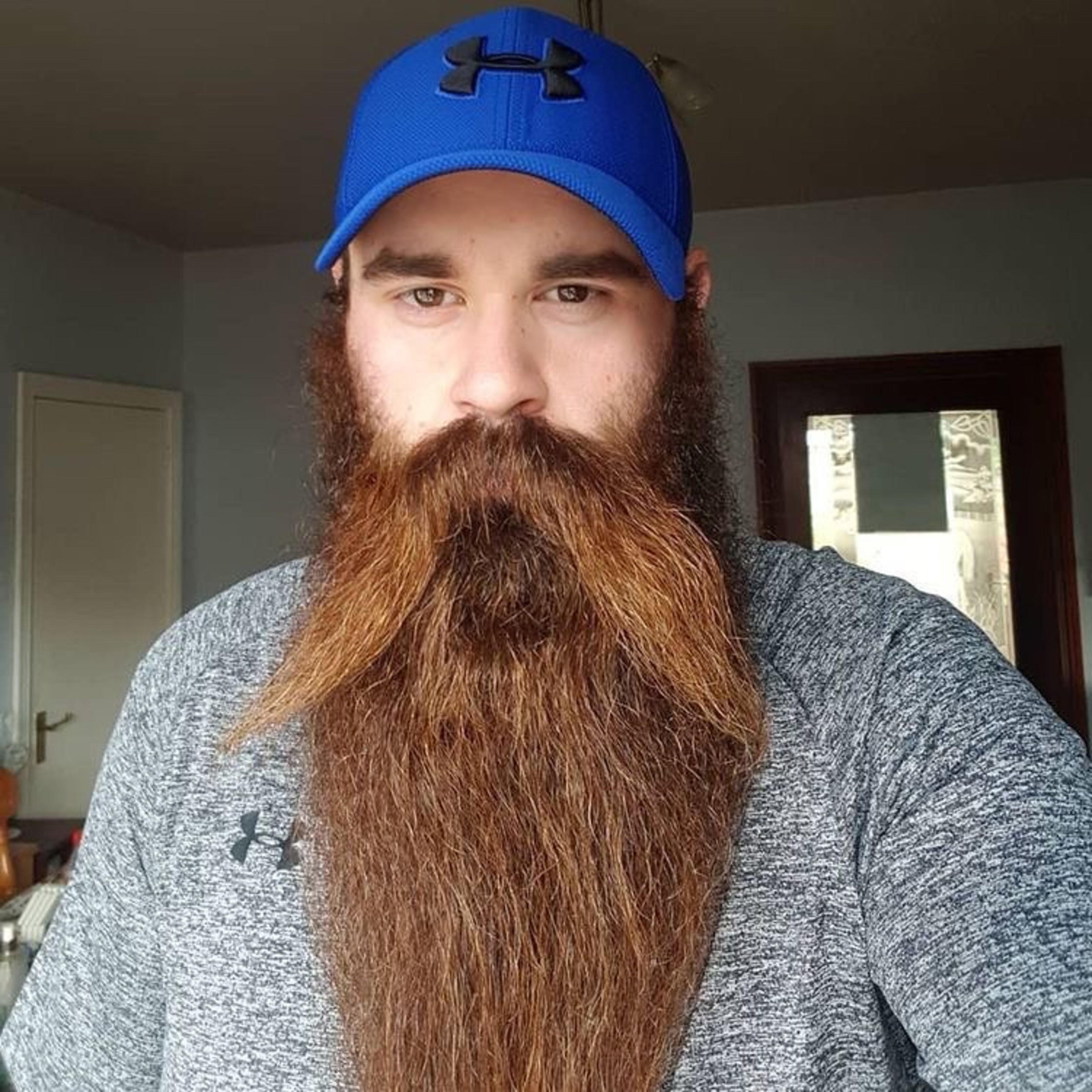 A really long stylish beard for males.