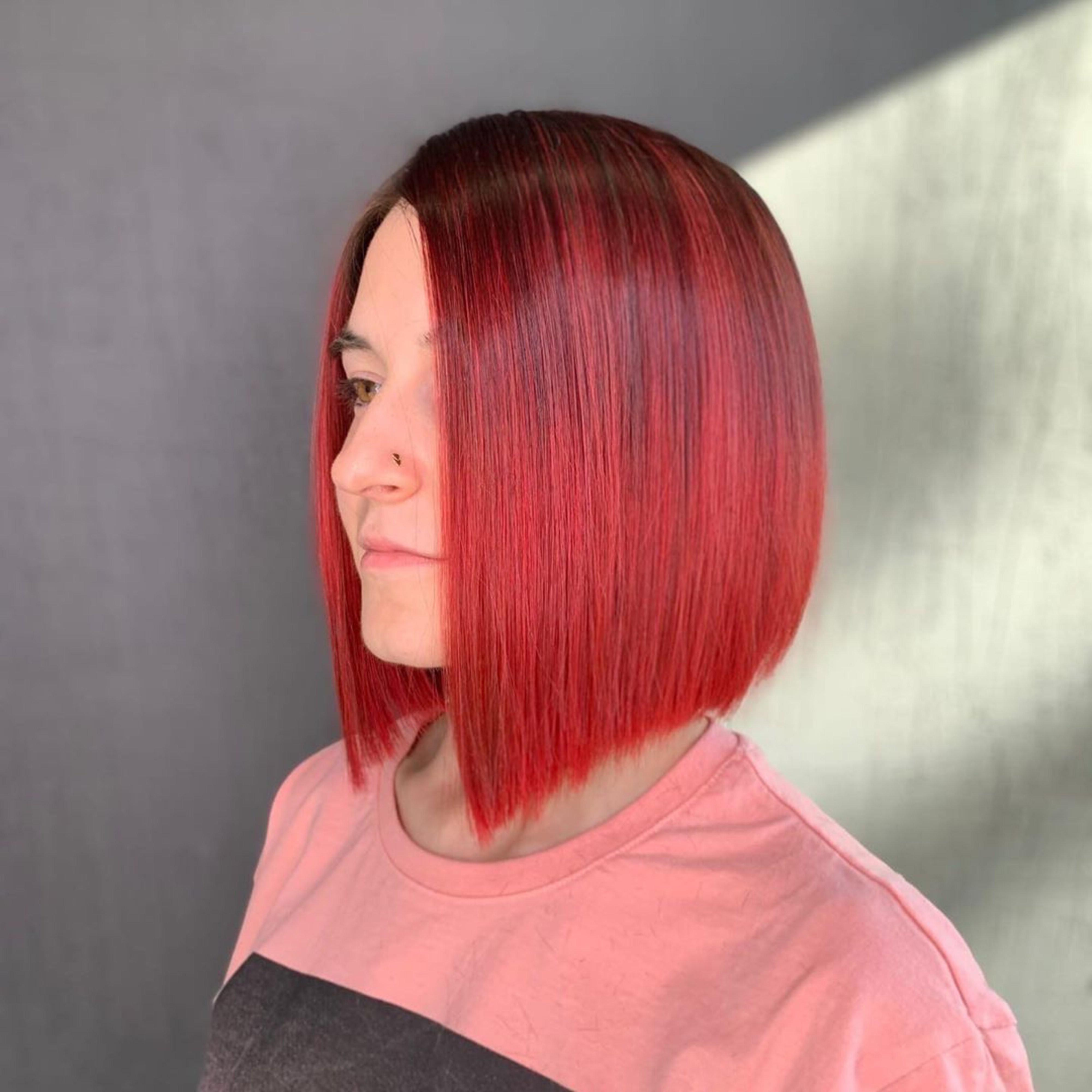 A red bob haircut.