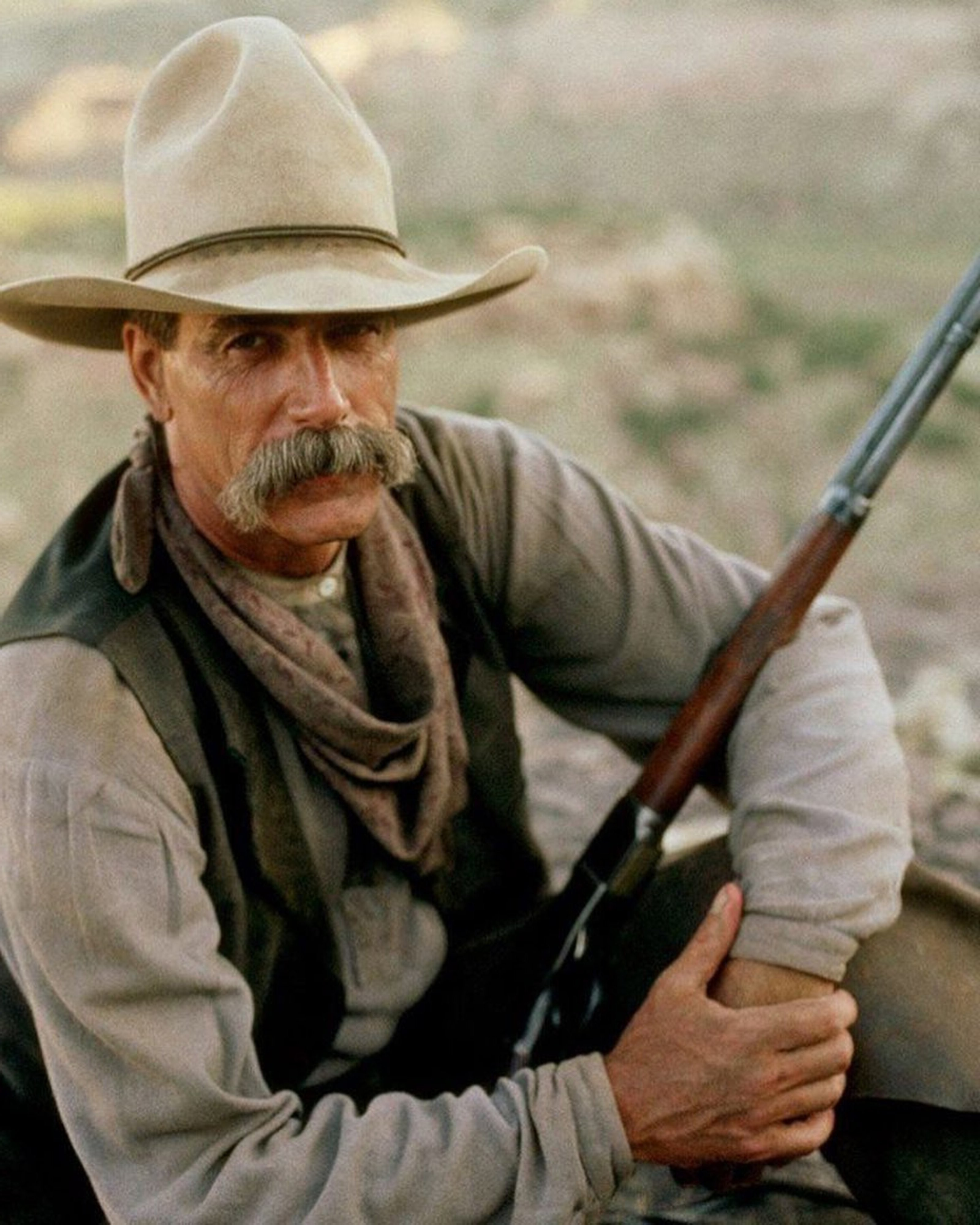 Handlebar mustache in the style of Sam Elliott.