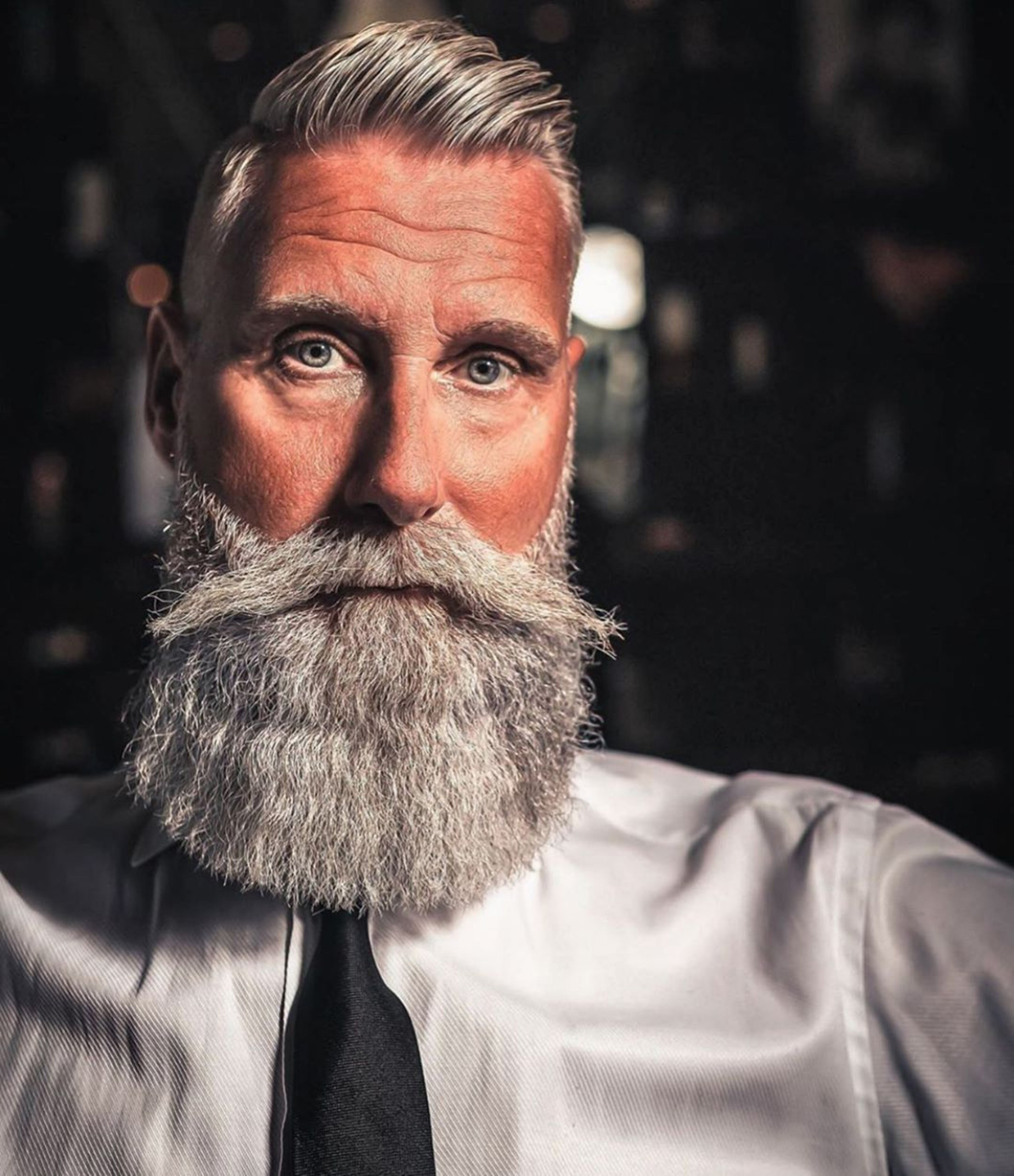 A short haired style with a long beard.