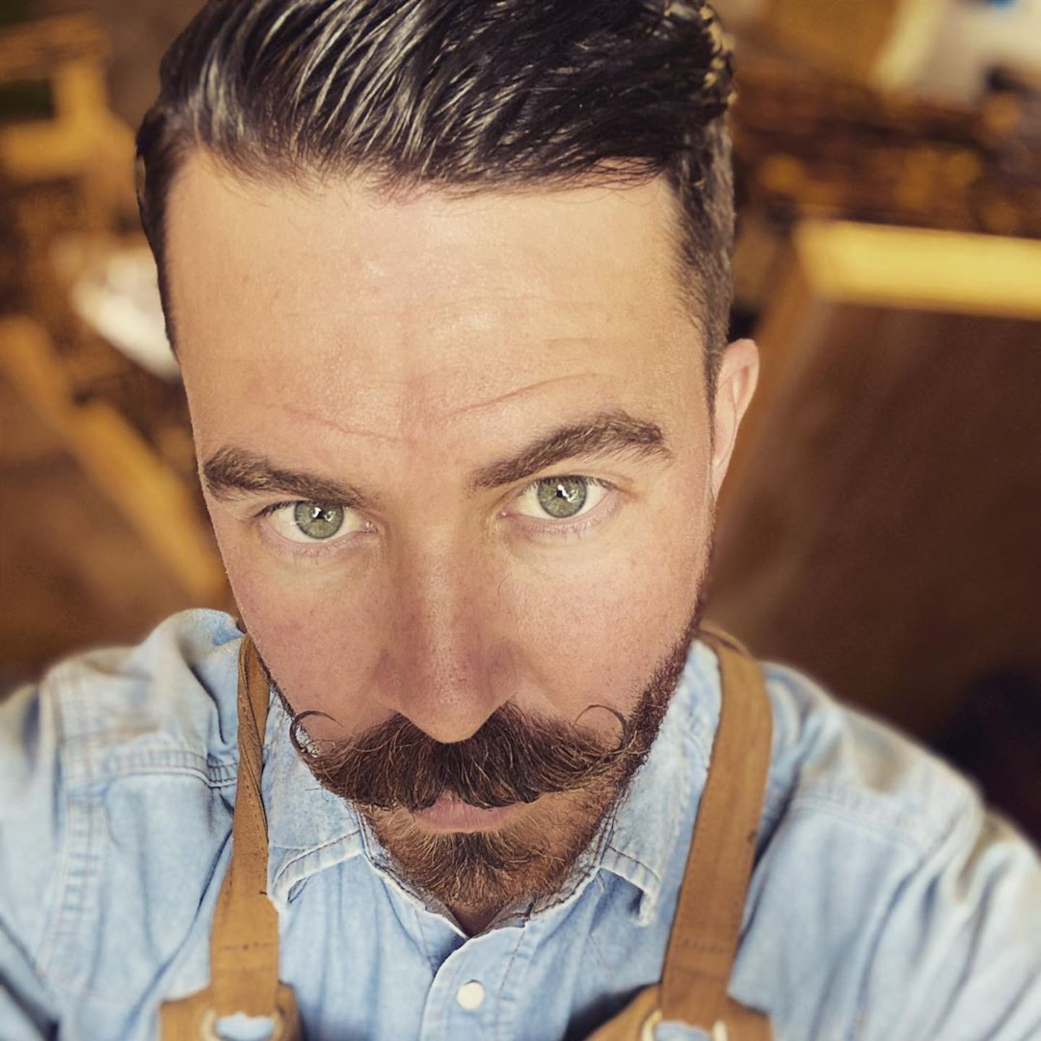 An upside down handlebar mustache for men.