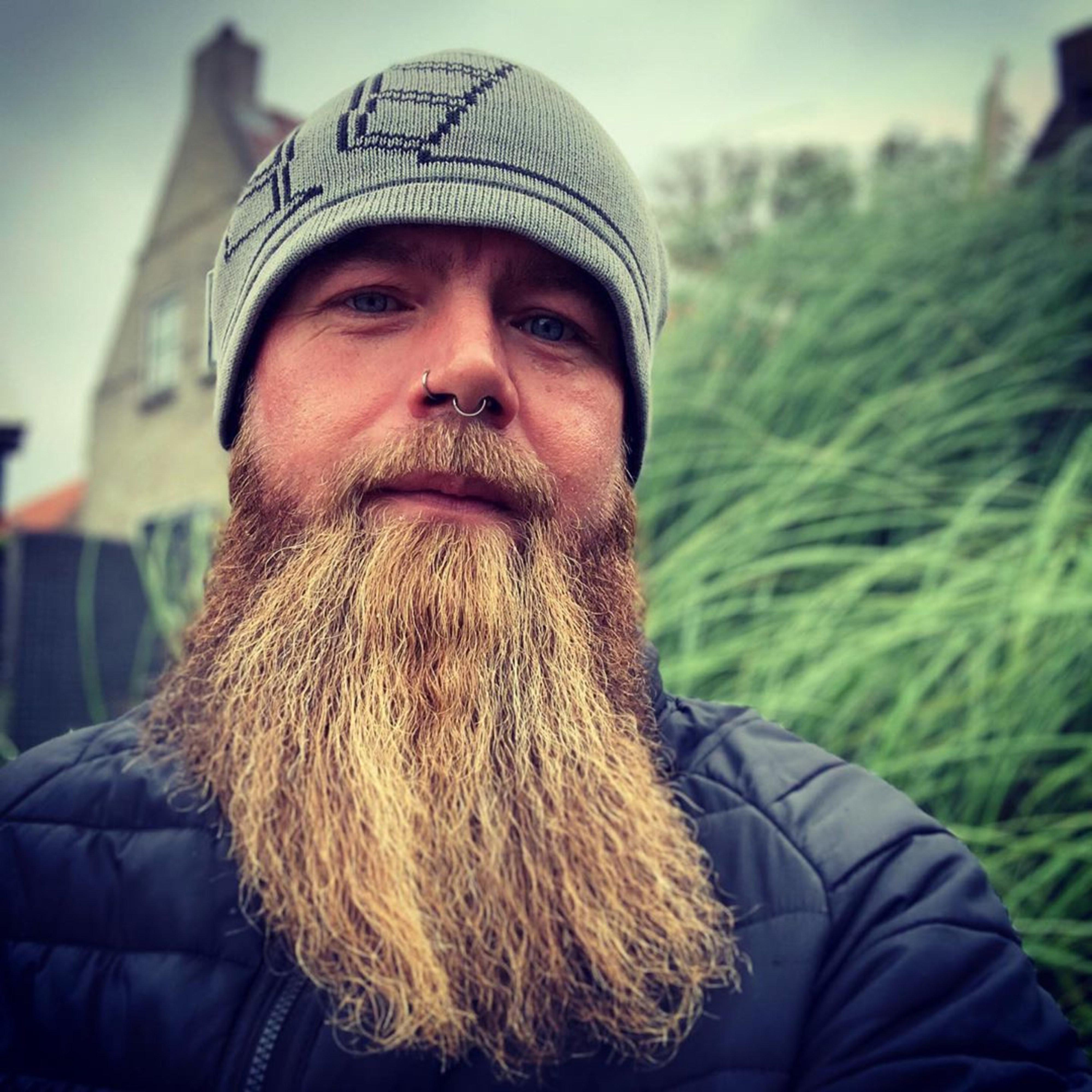 A long beard of the brown hair.