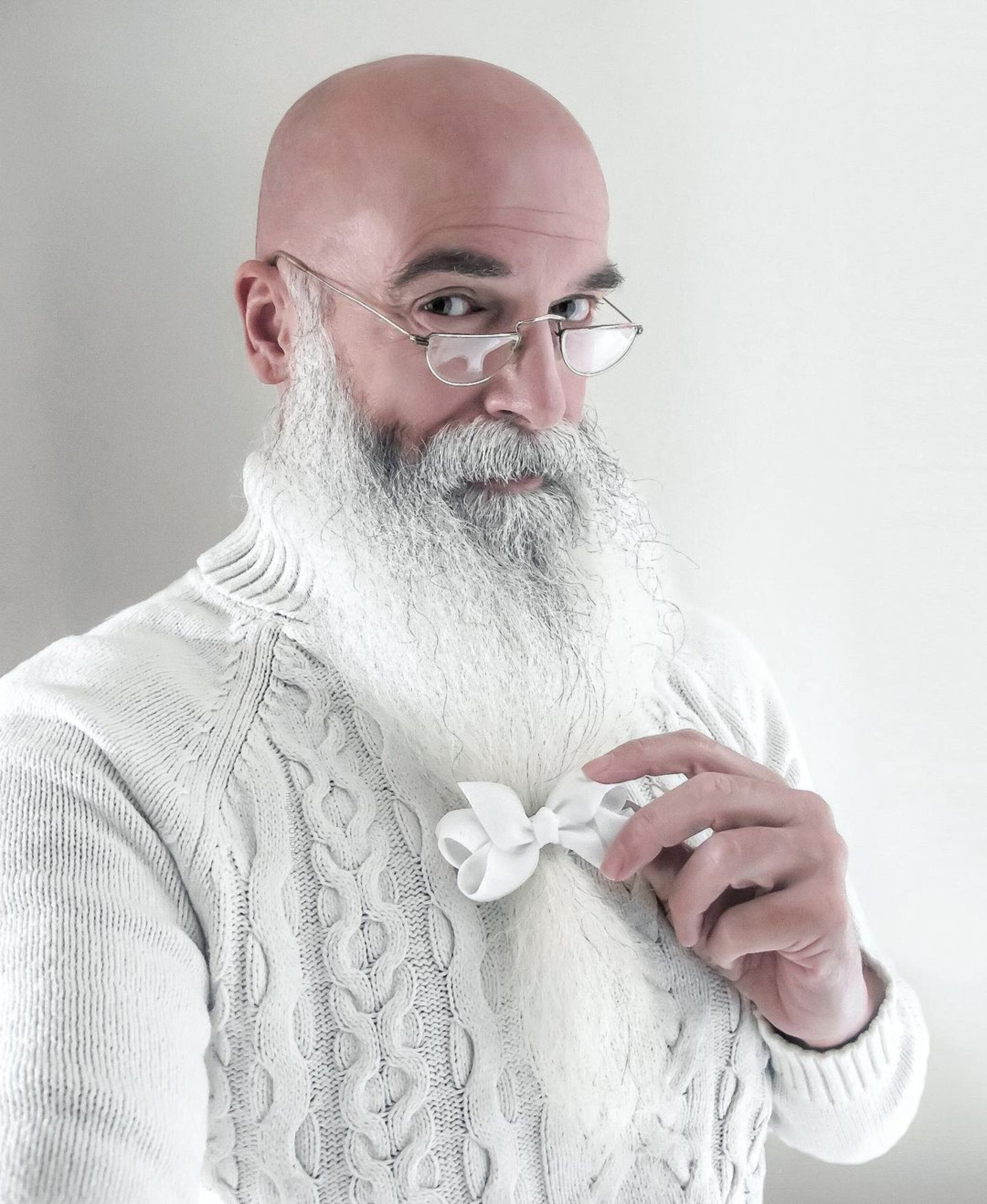 A long beard of the white color.