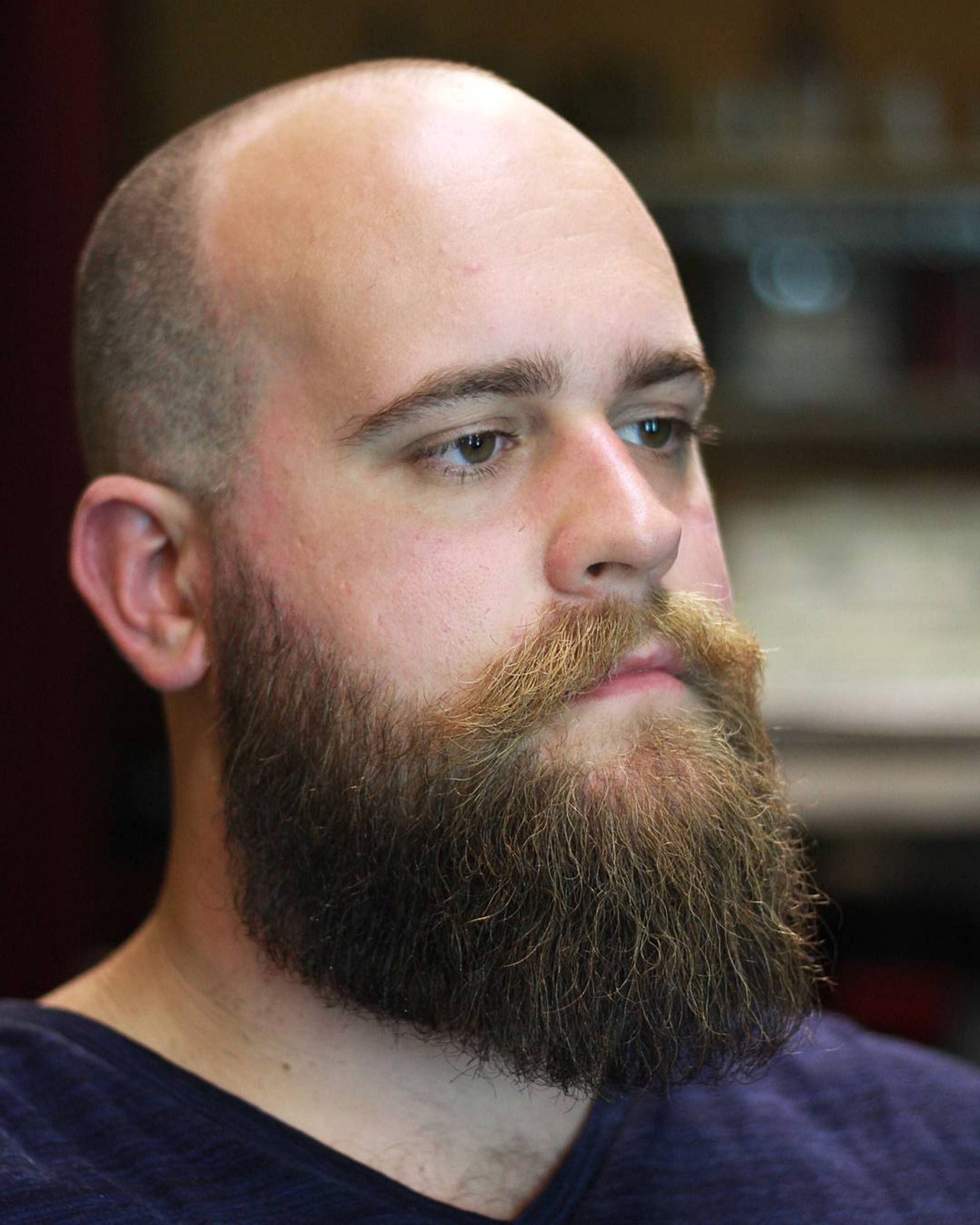 A full beard with a buzz haircut.