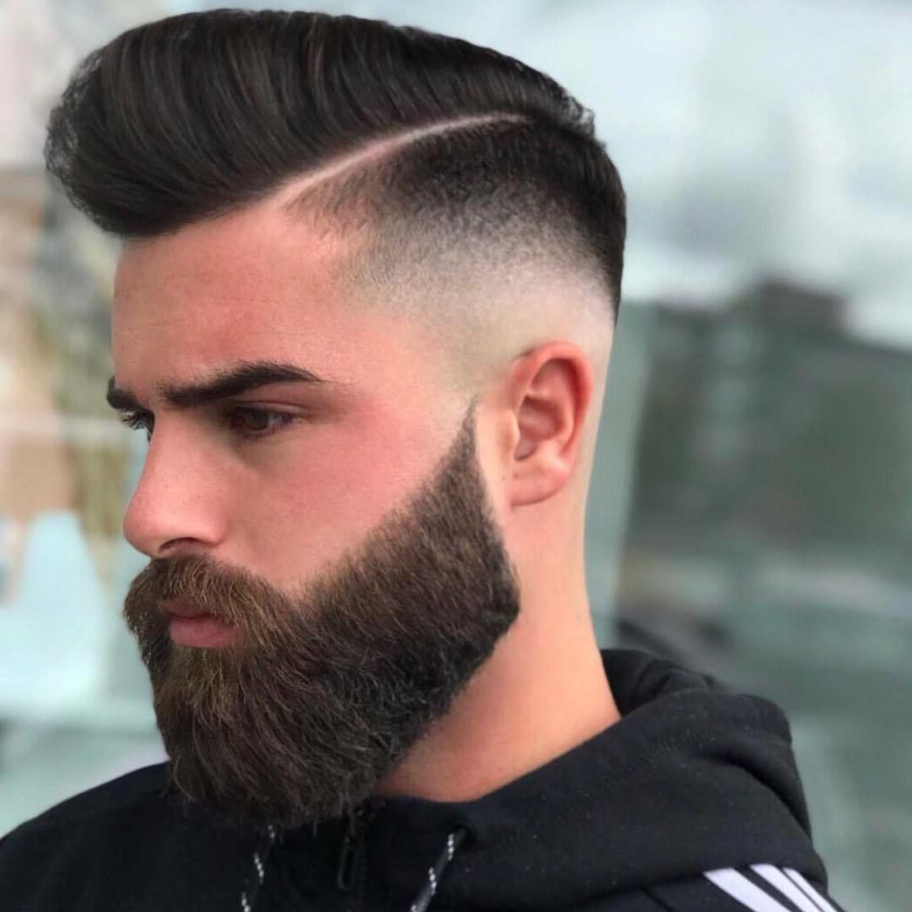 A full beard for men with a crew cut and high fade look.