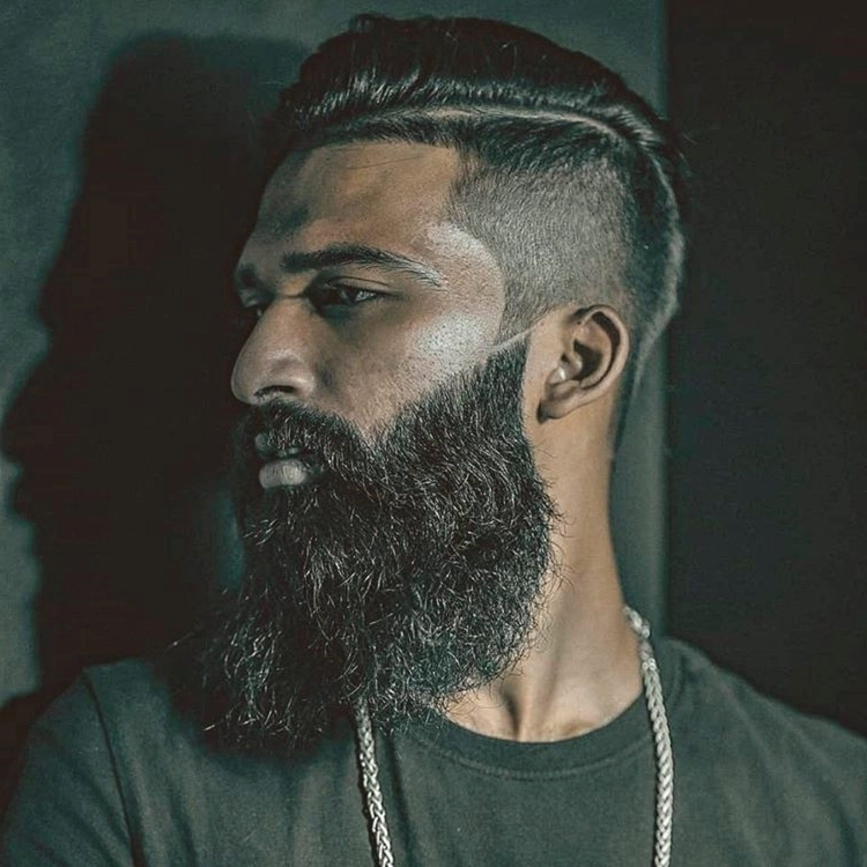 A full beard with short sides for men.
